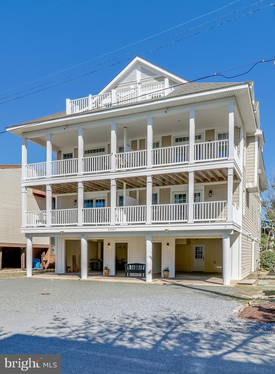 Welcome to your beach house in Tower Shores! Just steps to the beach, this east-facing duplex is ful
