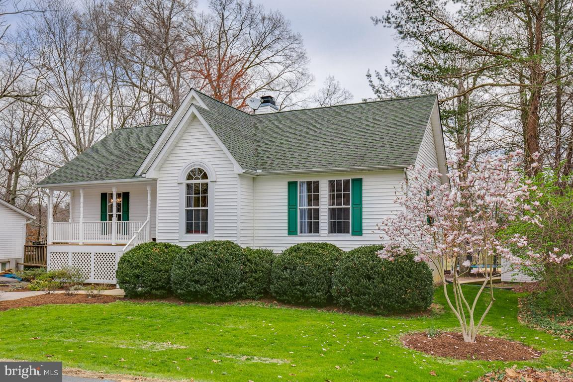 GOLF COURSE LIVING!  This rambler, situated on the fairway of Chesapeake Hills Golf Course, has it a