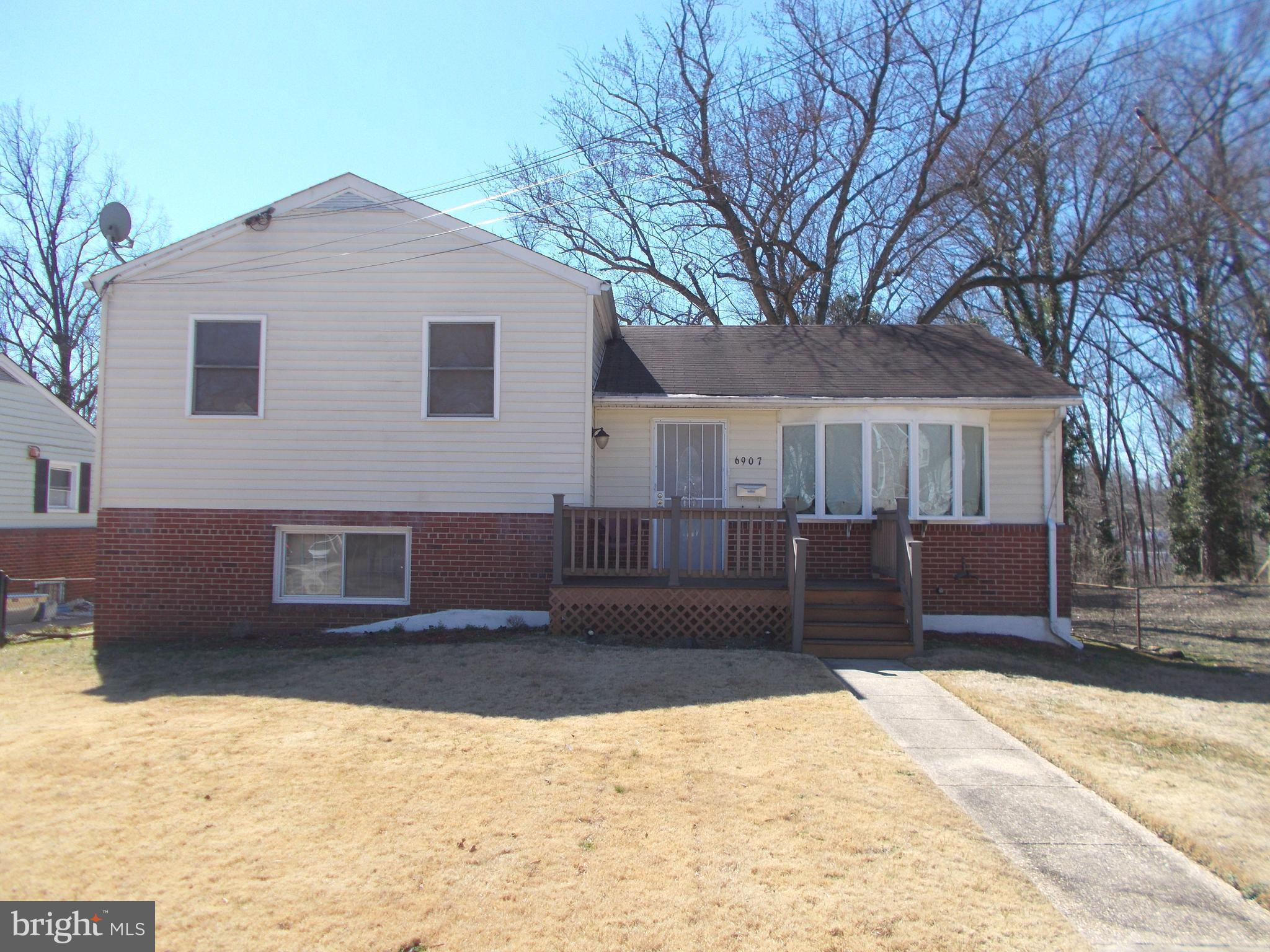 This split-level home offers 4 beds and 2 full baths, hardwood flooring throughout, stainless steel