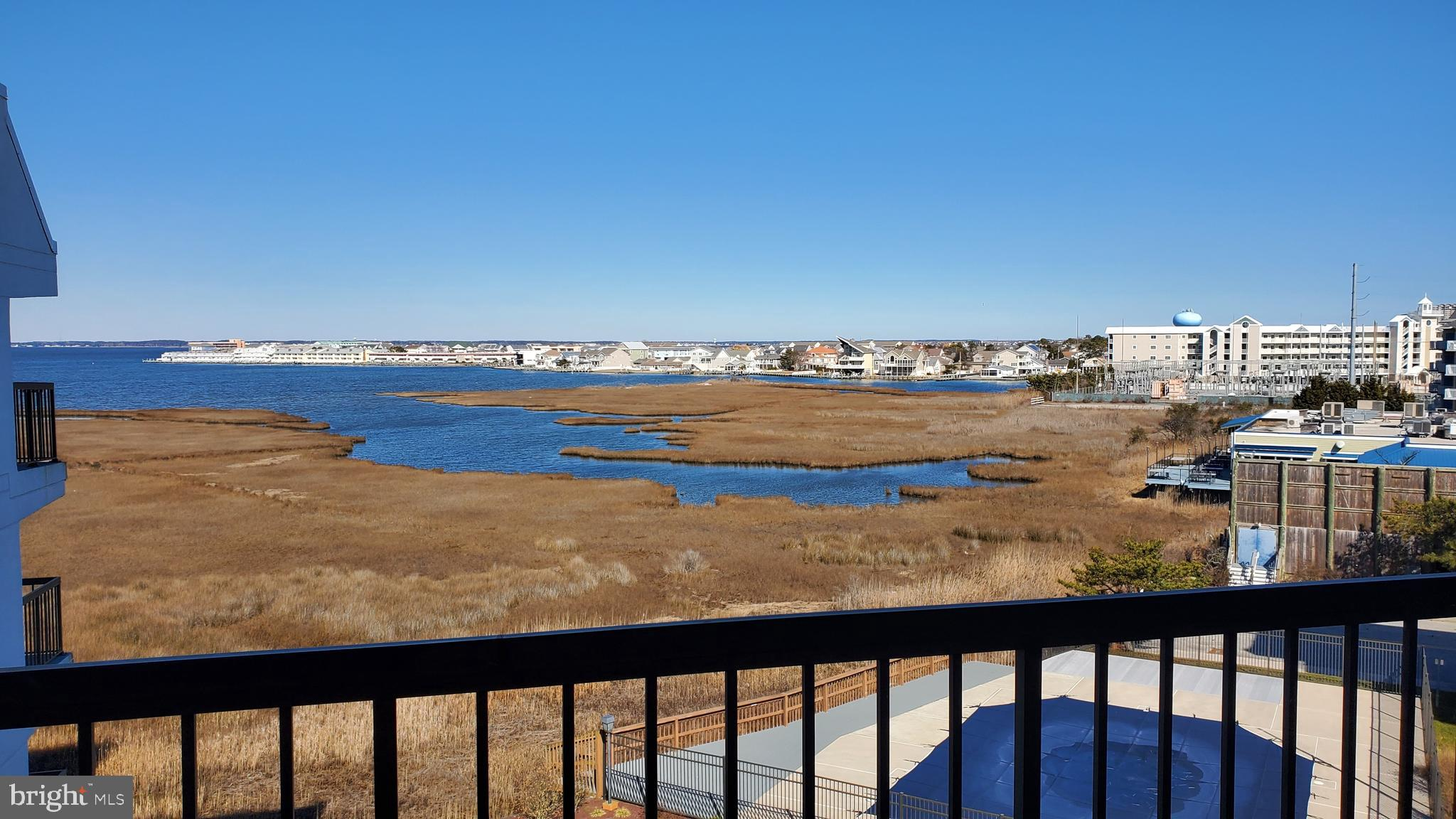Just Two blocks to beach is this Direct Bayfront condo in a Masonry Building with elevator and pool.  Enjoy amazing sunsets and bay views from your oversized balcony.  Spacious 2-bedroom, 2 bathroom @ 1115 sq ft. features an open floor plan with bay  views from the kitchen, living room and dining room.   The condo is being offered fully furnished with a sleeping  capacity of 11.  All you need is your beach gear! Must honor existing rentals.  6/26 - 7/2 for 2632.00 and 6/6-6/13 for 1924.50.  All future rentals have been blocked due to sale of unit.