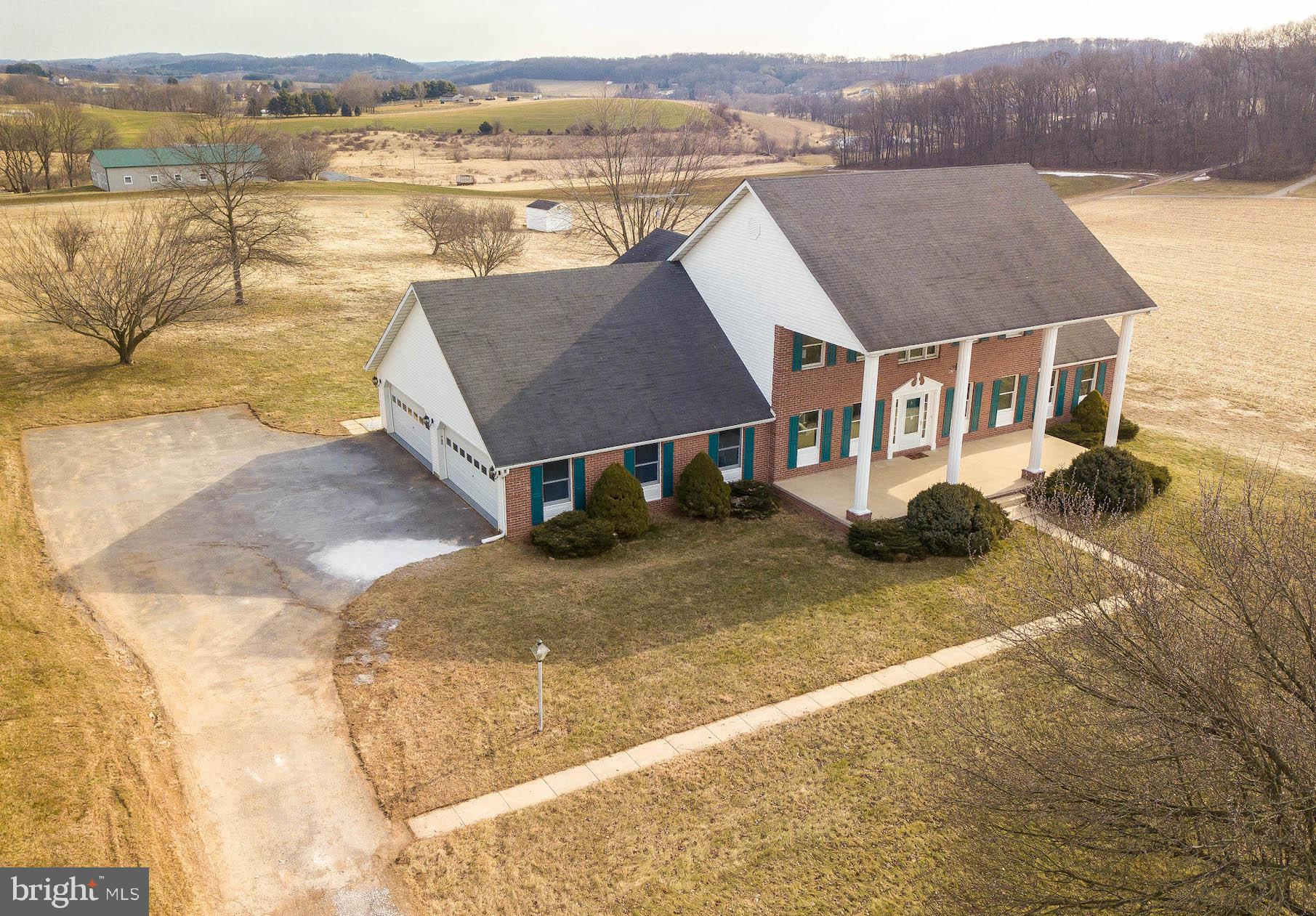 YOU HAVE TO SEE THIS ONE!! Over 4000 square feet of living space and situated on 3.3 acres....surrou