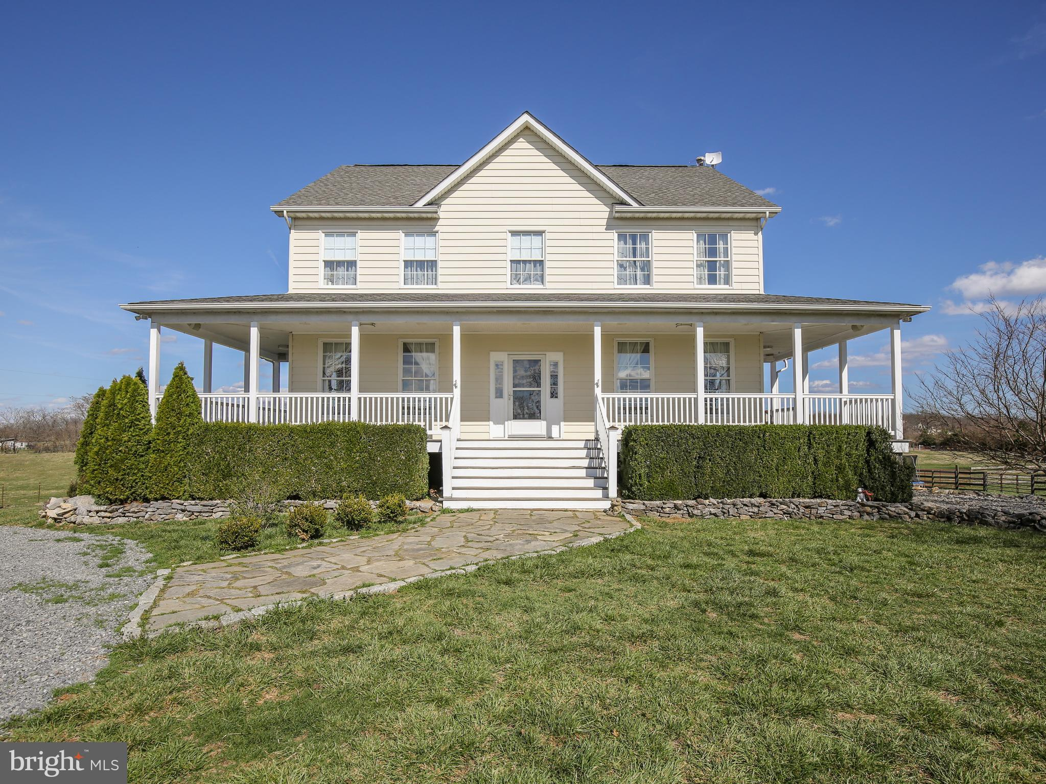 Surely a show stopper!    No stone left unturned in this custom 2400+ square foot farmhouse!  Situat