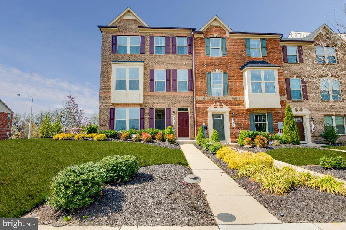 Live in class and convenience in this beautiful, spacious, end-unit former model townhome for the No