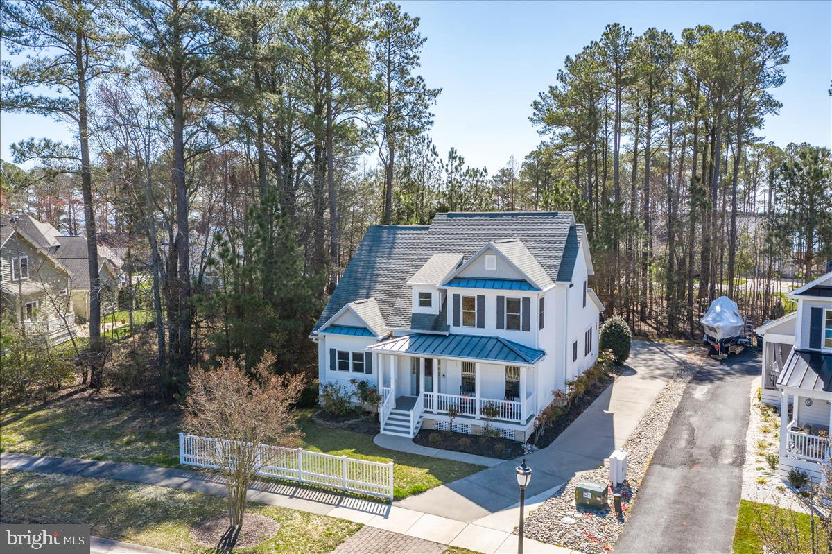 Striking 4BR/4BA home overlooking the pond and fountain in The Pointe at Ocean Pines hits the market