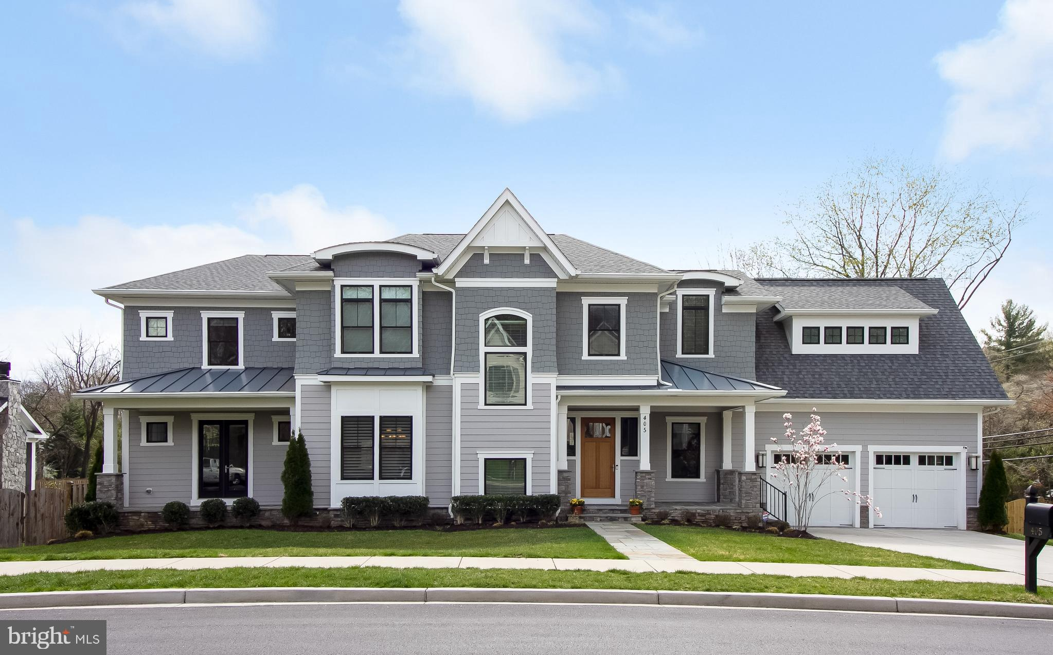 Spectacular custom built home located mins from downtown Vienna. Over 7118 sq ft of open living space. 6 BR, 6.5 BA, 10 ft ceilings. Gourmet kitchen w/high end appliances, sub-zero refrigerator and Wolf gas range with sealed burners and ovens, butler's pantry. Main level in-law suite w/ full ba. Great room with gas fireplace. Master suite with huge walk in closet and custom shelving, gorgeous bathroom w/deck. Finished lower level w/rec room, theater, wine, wet bar & gym and guest suite. 3 car garage.