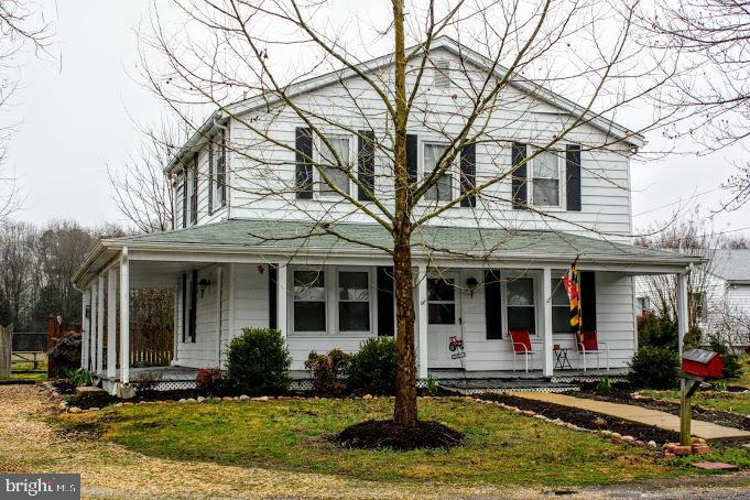 Don't miss this opportunity to own a charming updated farm house with a wrap around porch on over an