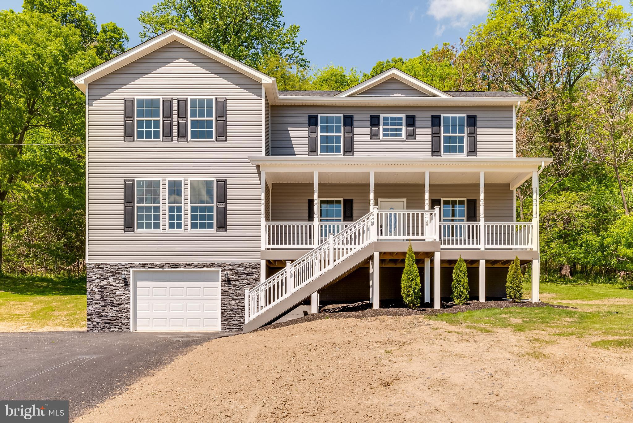 Welcome home to amazing views and over an acre of unrestricted land to call your own. The main level
