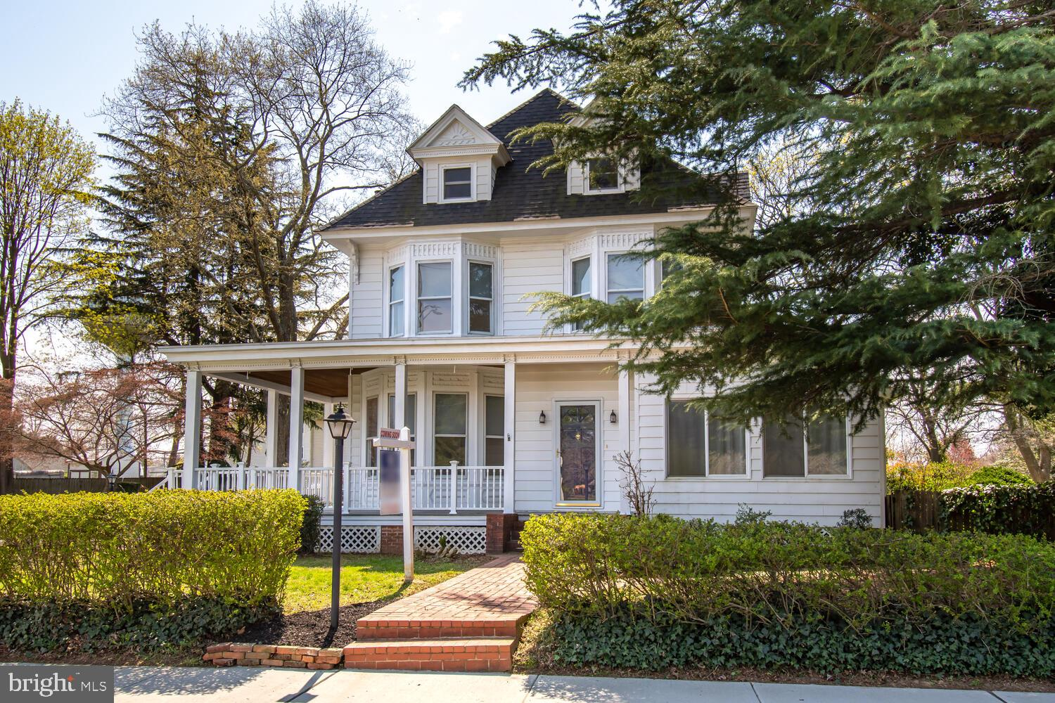 Lovely Victorian Home with original details, gorgeous moldings, staircase, large windows bring in lo