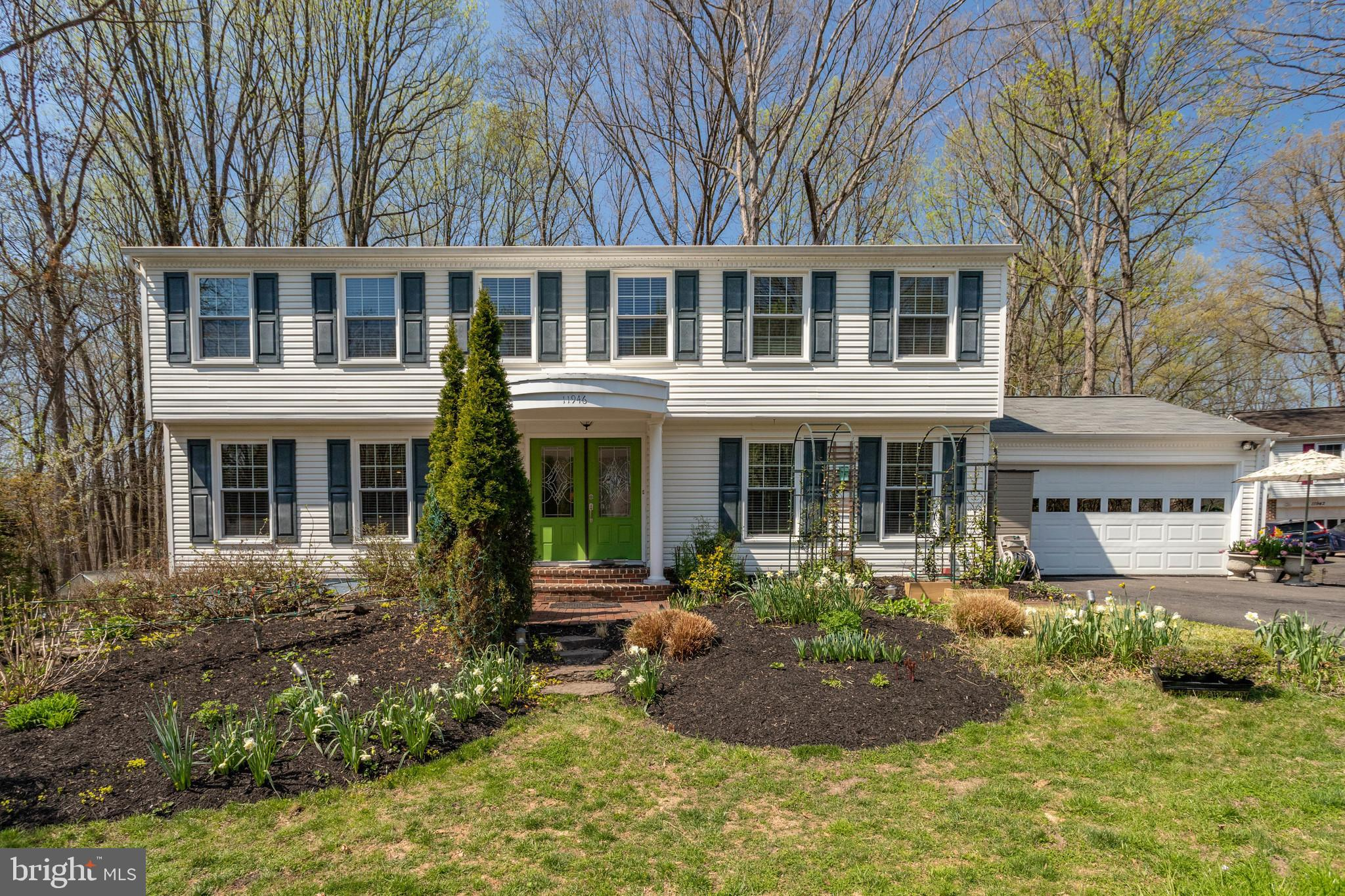 Welcome to a stunning five bedroom Colonial, set back from the street, and sitting on approximately