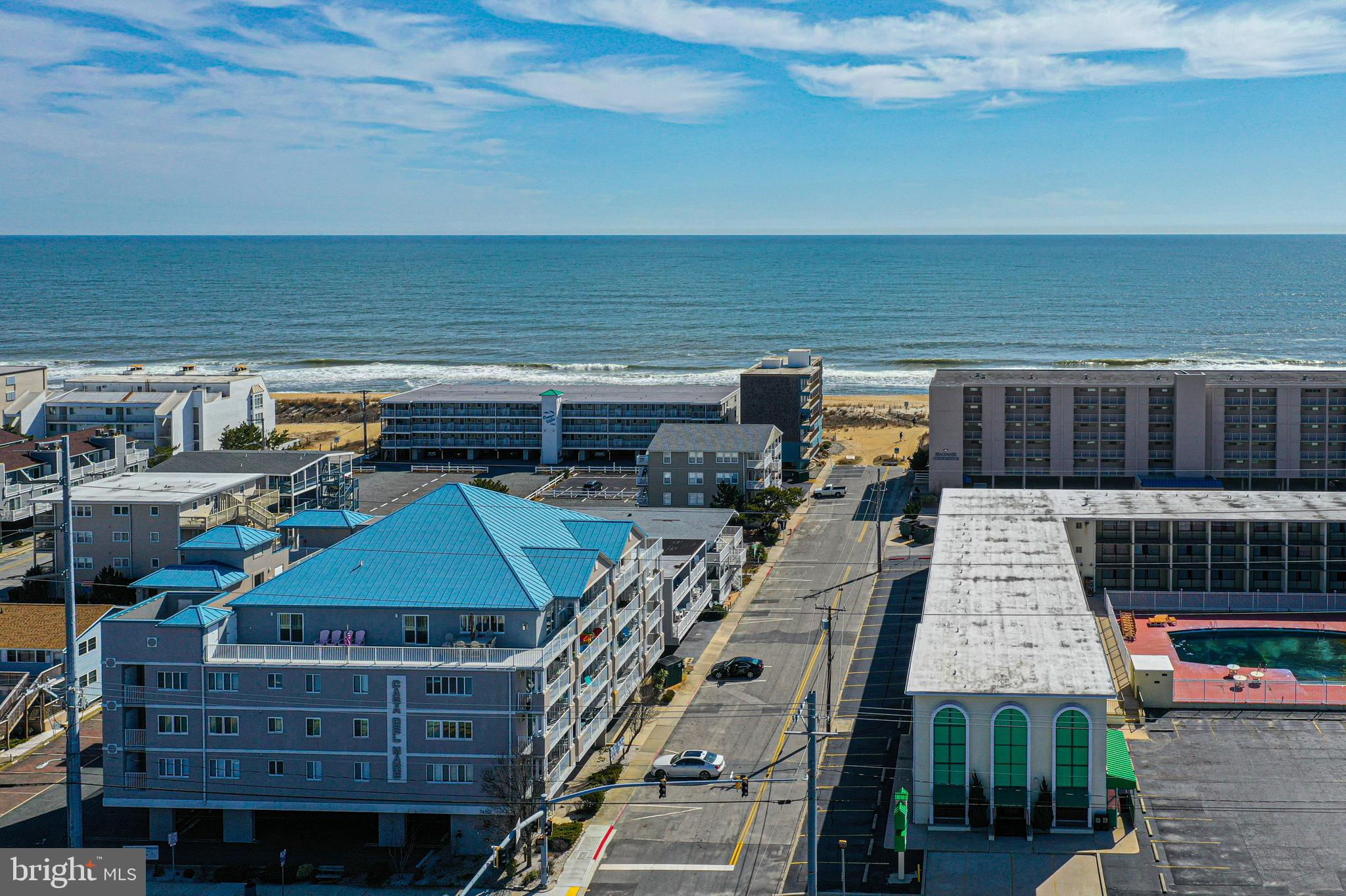 Amazing 3 bed 3 full bath Southern Exposure condo with both bay and ocean views!  The spacious open floorplan offers kitchen with newer appliances, breakfast area, living room, gas fireplace, laundry room, covered parking, secured building, outdoor shower, and private storage closet.  Great mid-town location Mid-Town within steps to Ocean City Beach, shopping, restaurants, entertainment, and easy access to rt. 90.  This one will not last long.  Call for a private showing today.