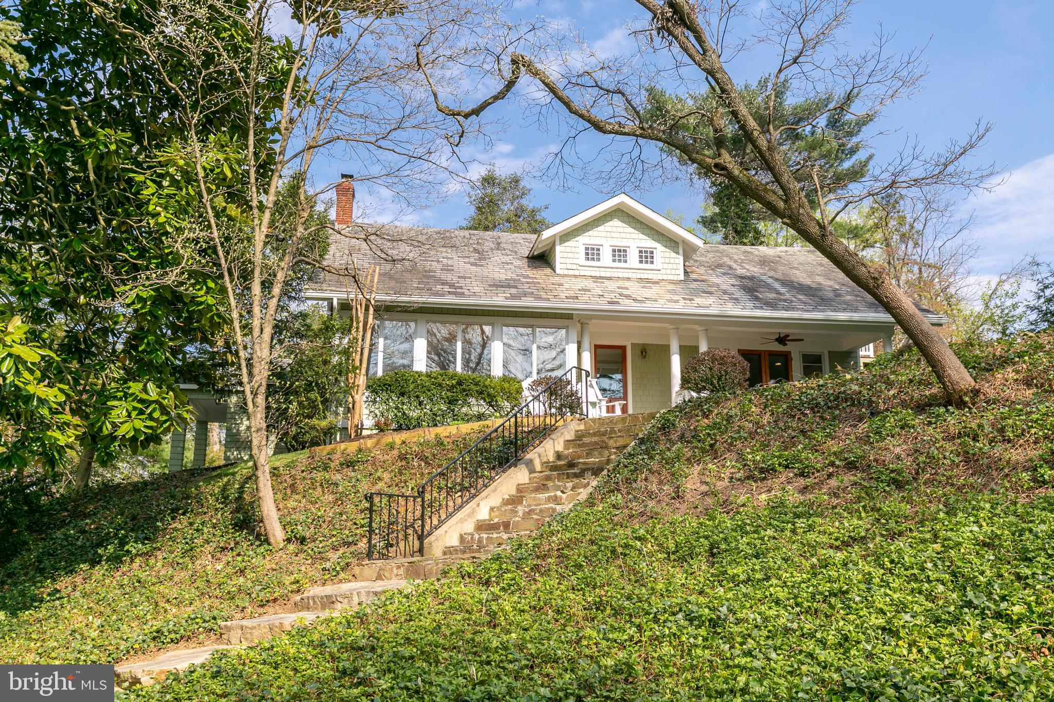 Perched atop one of the highest points in Round Bay, surrounded by nature, is this charming 1930's r