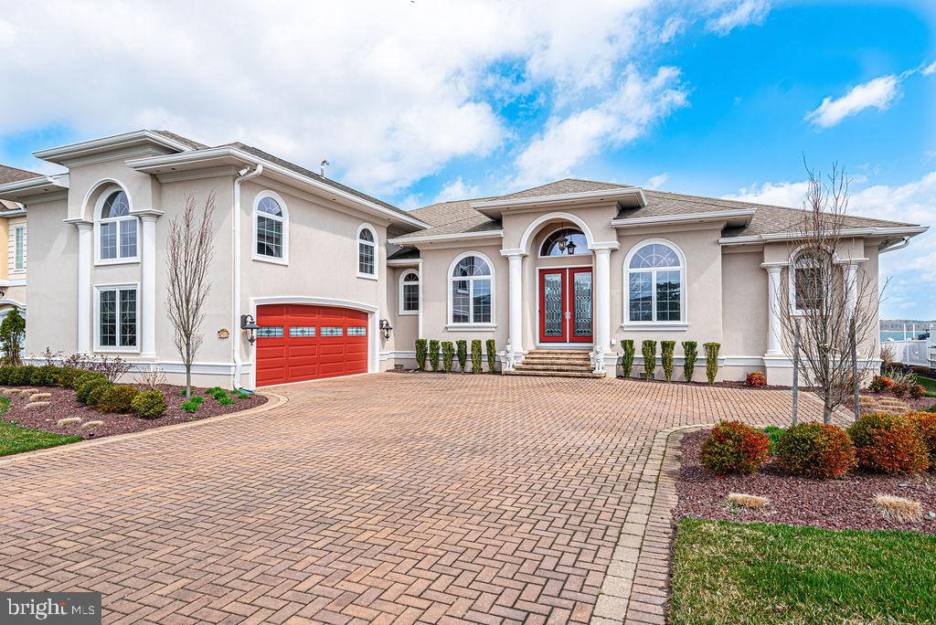 Beautiful bayfront home is like an Island Oasis  extensively remodeled 2017 All top of the line features and materials Has private outdoor heated pool and outdoor kitchen.  Boat and jet ski lifts Decorator furnished!