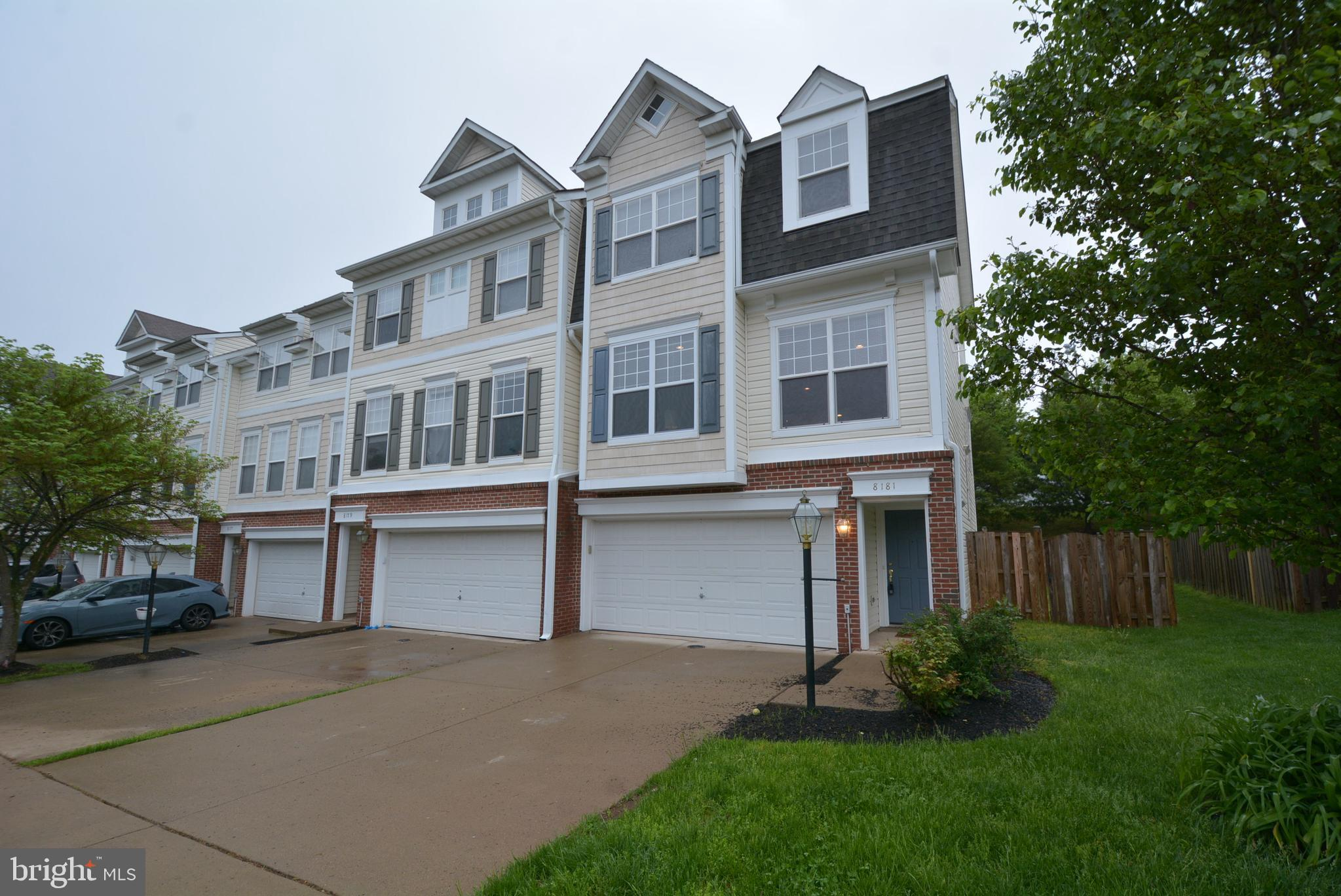 Welcome to this beautiful, well maintained open & bright 3-level, 2-car garage, end-unit TH. All new