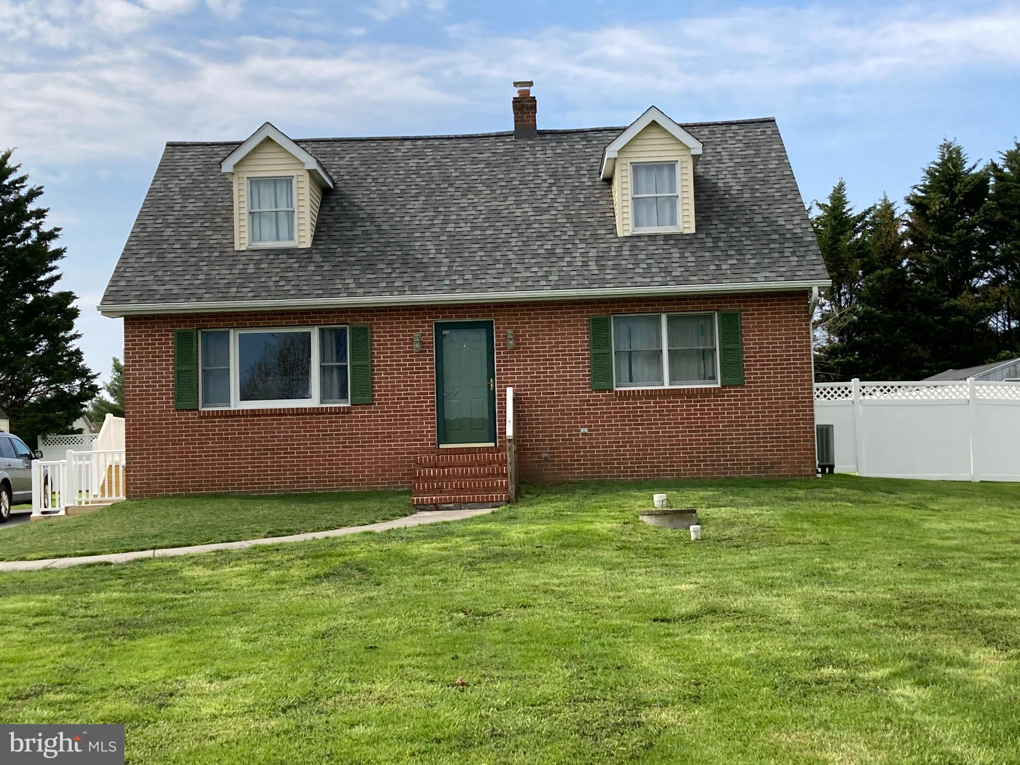 Newer roof installed 2018. Newer renovated brick front Cape Cod with newer kitchen with ceramic tile