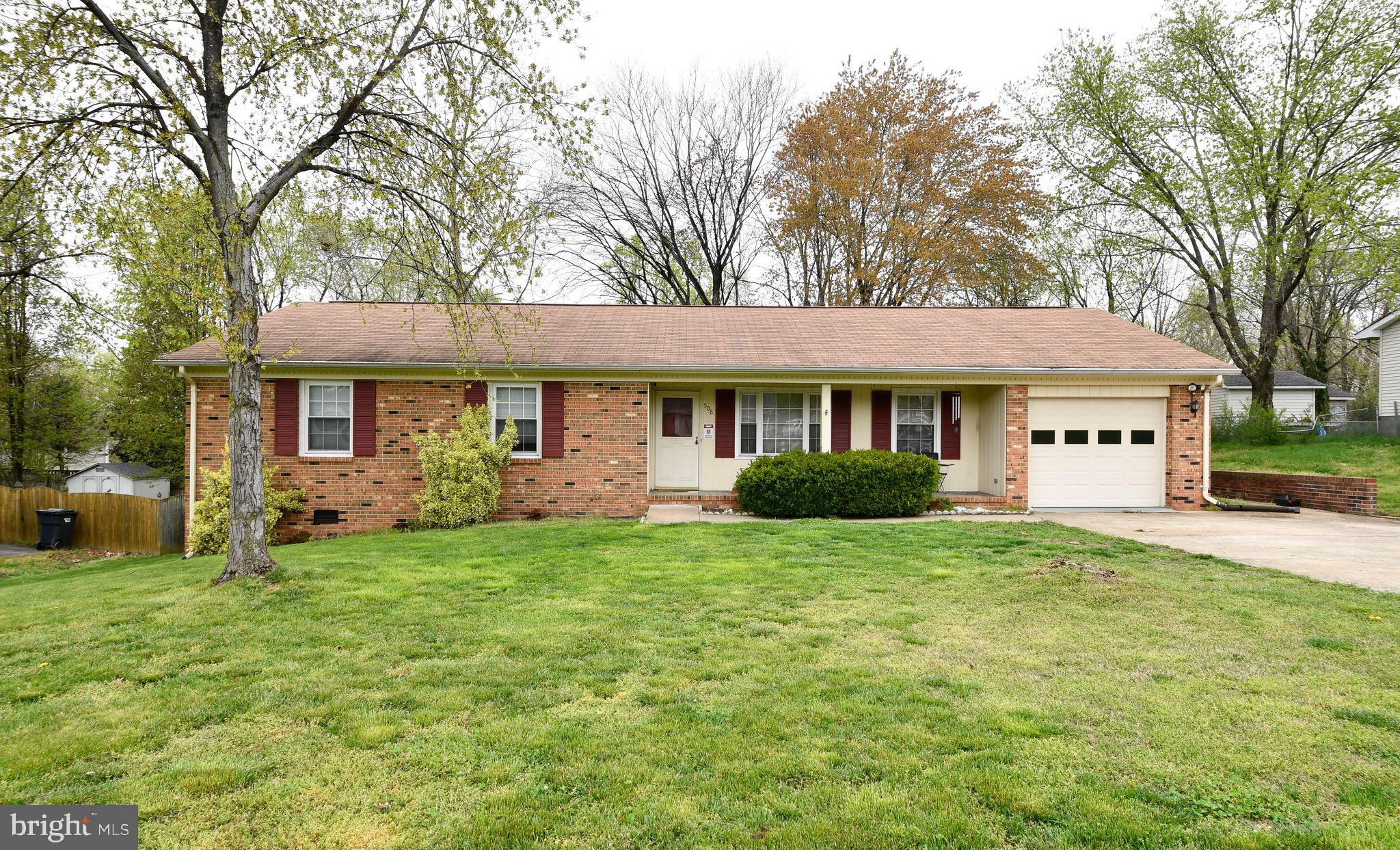 Stafford county brick rambler with an inviting front porch.  Hardwood floors throughout . Updated ki