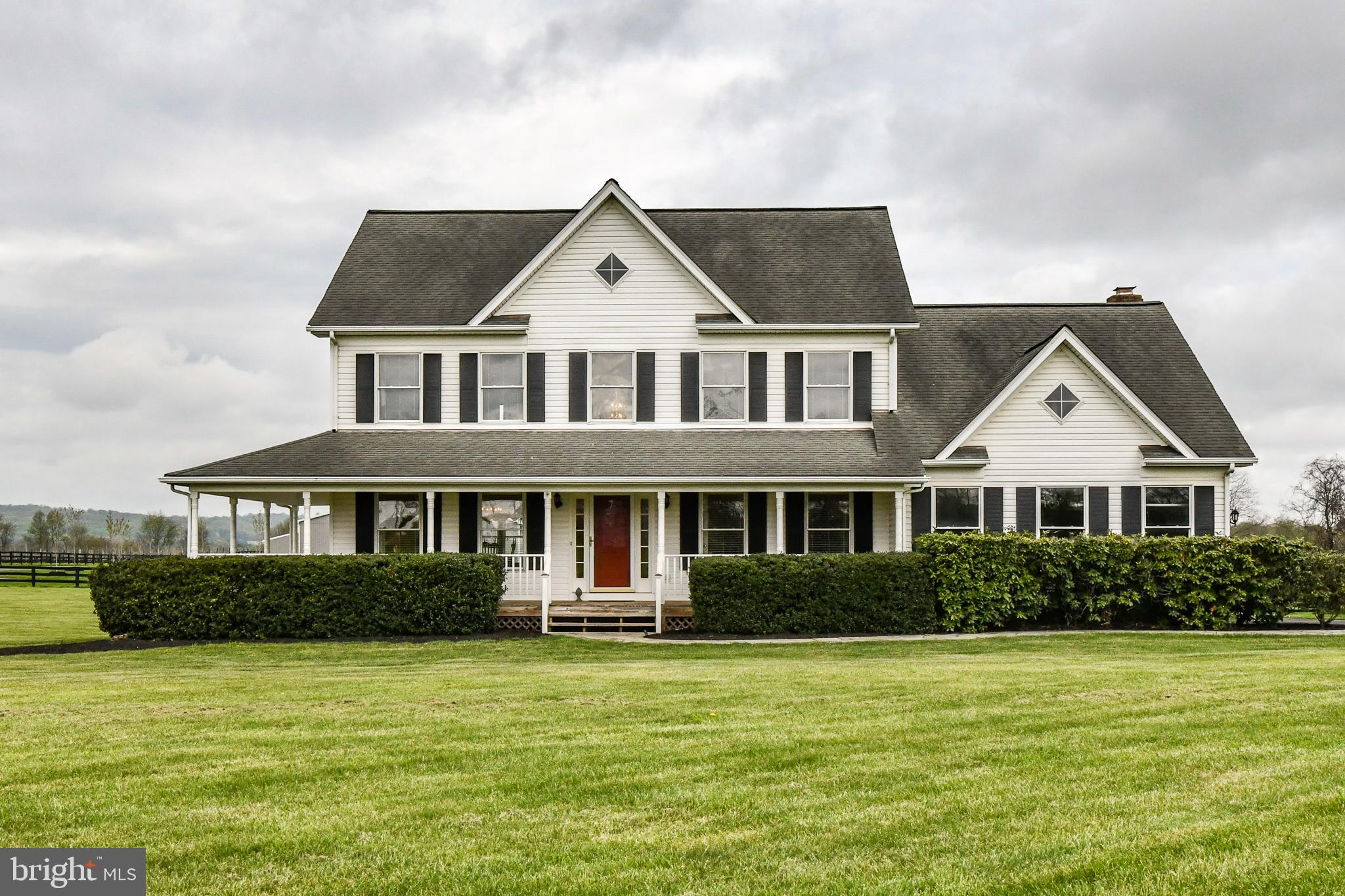 Located in the heart of Virginia wine and horse county, this lovely home on 3 acres has a wrap aroun