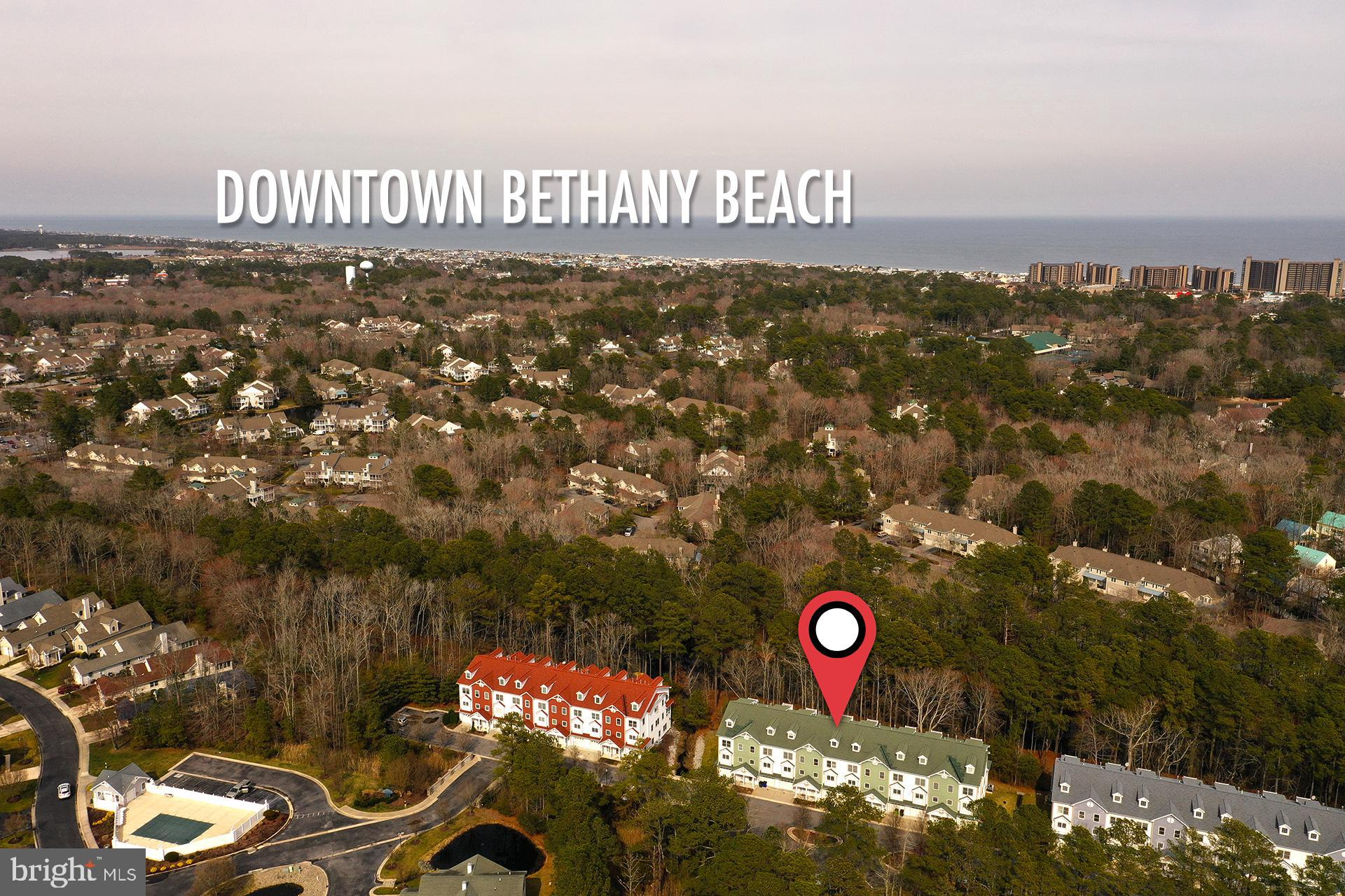 """Luxury townhome, in excellent condition,  located in the tranquil, wooded setting along the Assawoman Canal in Canal Woods, a subdivision of the Waterside community, just a short bike ride to the Bethany Beach and Boardwalk.  (approximately 1.9 miles)  This community is directly across the canal from Sea Colony West.  Town home is loaded with upgrades; spacious, open floor-plan, private elevator, hardwood floors, ceramic tile and marble flooring to name a few.  Living area with gas fireplace and custom built-ins, built-in speaker system and intercoms throughout the home.  Upgraded kitchen with 42"""" cabinets, granite countertops, double oven, propane cooktop and island with breakfast bar, and dining area.  Large Owner's ensuite with whirlpool tub, gas fireplace, and large walk-in closet.  3 additional ensuites to allow for plenty of family or guests.  Garage offers space for additional storage for Kayaks, fishing, other beach gear or car.   Excellent rental income!  This won't last long!"""