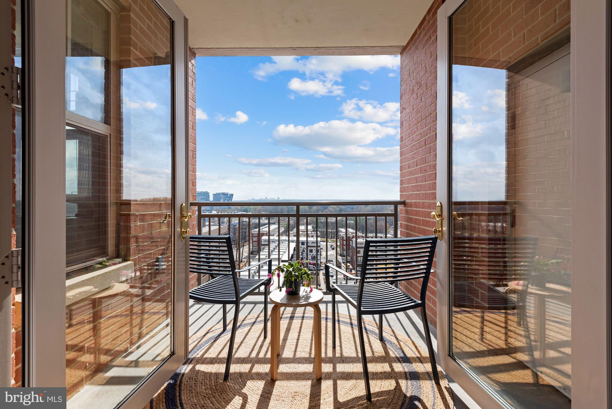 Enjoy your morning coffee while watching gorgeous sunrises from the 9th-floor balcony of this FULLY renovated home.  No expense OR imagination was spared from the custom cabinetry installed in the dining area to the beautiful NEW kitchen and gorgeous UPDATED bathroom.  Even the entry has a decorator's touch with its designer wallpaper.  This home is the definition of turn key! The Mercer enjoys many amenities, is within walking distance of TWO metro stops and is located next to new $1m townhomes.  Come see for yourself why this one stands out from all the rest!  Unit can be bought turnkey with all furnishings and decor for an additional fee.