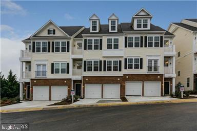 Welcome Home!!! Beautiful well maintained 2 level 3 bedroom 2.5 bath Condo with high ceilings throug