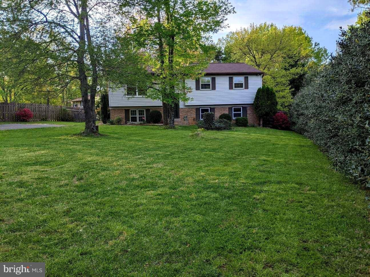 Highly sought after Nokesville (Prince William County zip: 20181) Active as of 4/23/2021... No HOA.  All Offers will be Responded to by the following Business day.... Welcoming Brick and Siding split foyer with updated Kitchen, Stainless Steel electric appliances, Large Living Room with Double Windows, Formal Dining Room w/crown molding, chair rail and French doors (with built in retractable mini blinds) leading to Screened Porch with stairs to large Level privately fenced Backyard overlooking your Apple and Pear trees while enjoying summer fun in the above ground Swimming Pool (equipment conveys) on .6488 acre corner lot.  Owner's Suite with Full Bath (shower/tub), 2 additional Bedrooms and 1 Full Hall Bathroom (shower/tub) on the Upper Level.  Lower Level includes a Large Family room with Masonry Fireplace, Brick Hearth and Wood Stove insert.  This home is on a private Well and Septic, Septic perk is for 3 Bedroom.  That being said, this level includes a Full Bathroom (tub/shower), 1 additional Room with full window/Closet and a Huge Recreation room with walkout level door to Backyard.  Note that the Rec Room can be converted back into 2 separate good size Den/Offices.  Newer HVAC (SEER 13), Newer Roof (5-6 years old), Well Pump/Pressure Tank 2021.  Original (38 yr old) Septic Distribution Box replaced April 2021.  Asphalt Double wide Driveway easily fits up to 6 vehicles.  Home has both FiOS and Comcast service connections.  Built in 1983.  School Zone: Brentsville High School, Nokesville Middle School, Nokesville Elementary School.