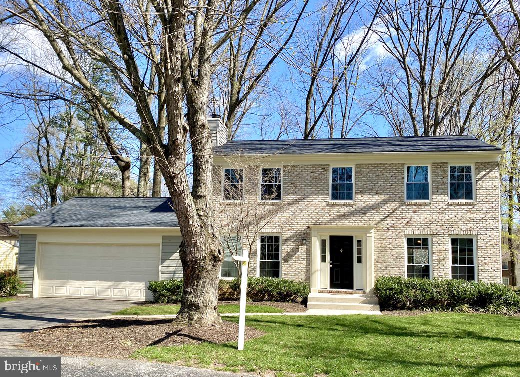 Beautifully renovated  brick front colonial with 4 bedrooms, 3.5 baths, and a 2 car garage in the so