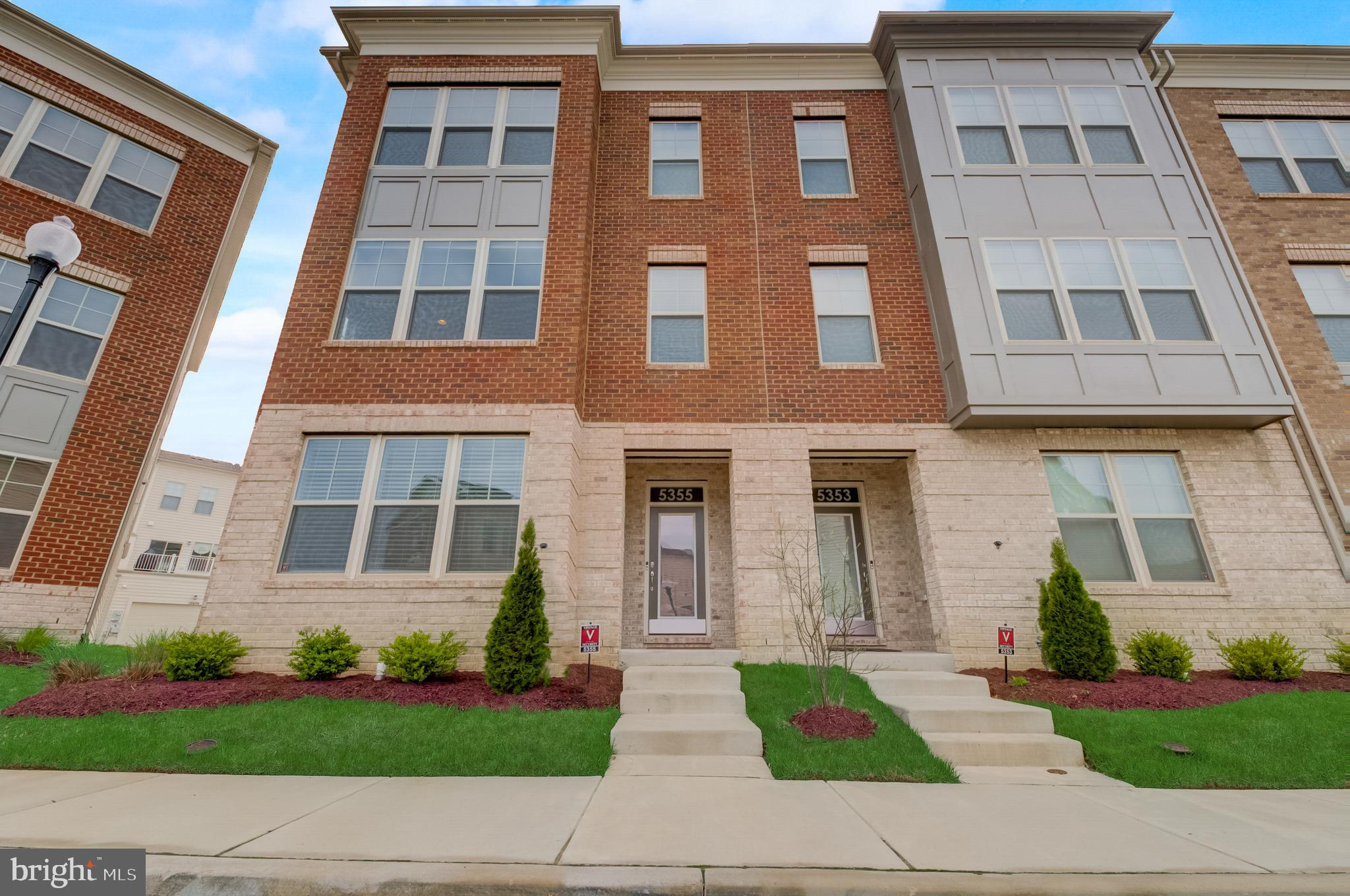 End unit urban style townhome in the desirable Westphalia community! 3 full finished levels with ove