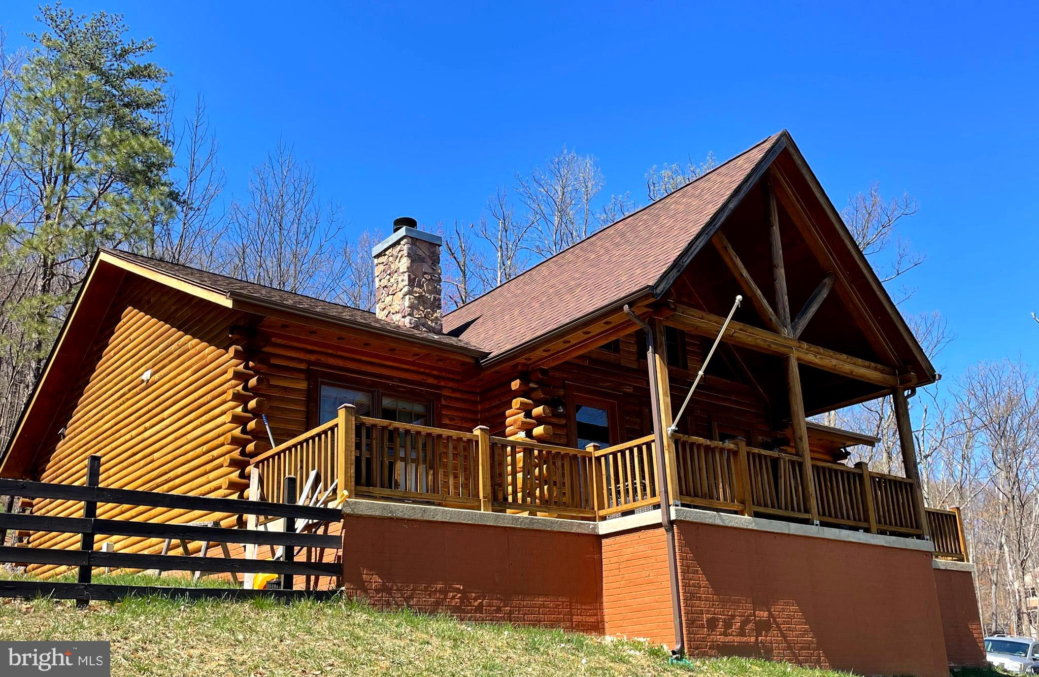 Your dream log cabin on the mountain is move in ready and waiting for you to call her home-sweet-hom