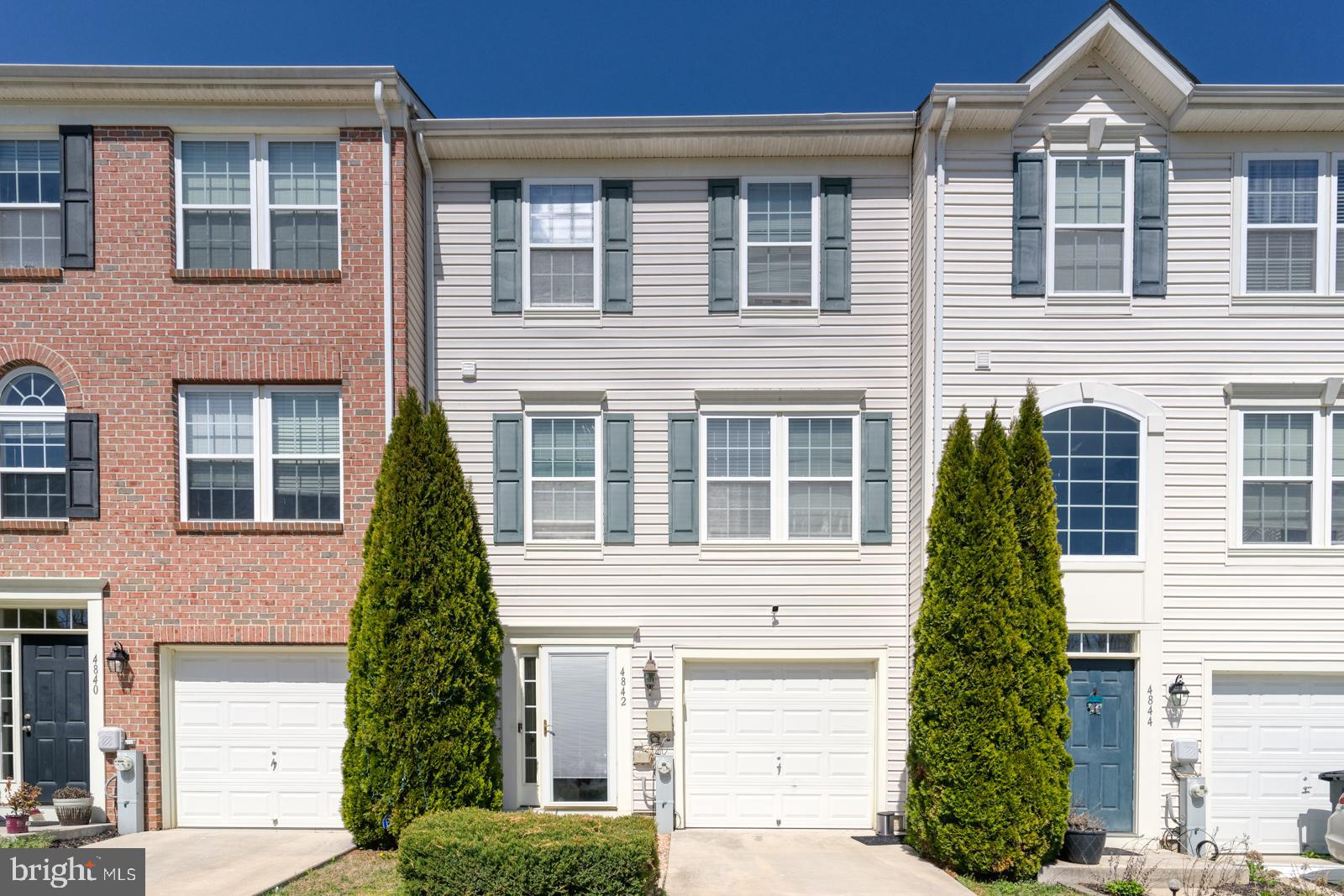 Welcome to 4842 Atlas Cedar Way! This fabulous 3 story garage townhome has 3 bedrooms with a potenti