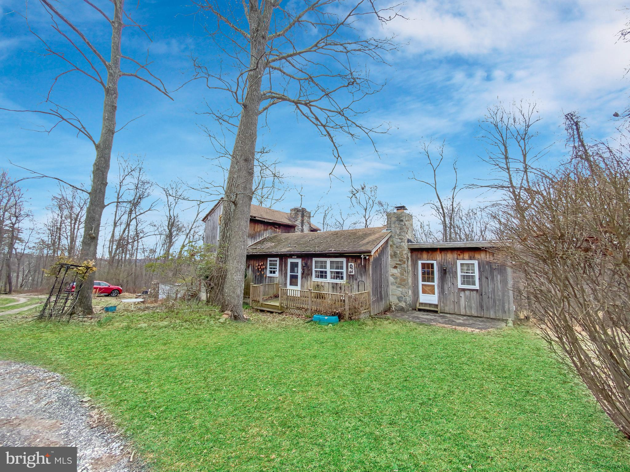 Beautiful views from the rear porches of your own steam! Home in need of renovation or tear down and build your dream home on a private road overlooking  a stream.  Bring your contractor and imagination. All offers considered.