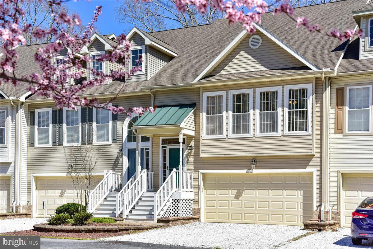 Looking for a place at the beach but you don't want to do any  maintenance? Then this is the place for you! This beautifully cared for townhouse is nestled in the heart of Ocean Pines, with views of the Robert Trent Jones Golf Course and just a short walk or bike ride away from the Ocean Pines Yacht Club. Enjoy the privacy and community afforded by the Townes of Innerlinks townhouses, while you relax in your 3 season room or on your deck overlooking the 12th fairway. The 2,400 sq foot open concept home has 3 bedrooms, 2.5 baths, and features a huge kitchen, cathedral ceilings, 9' ceilings throughout, granite countertops, 2 separate living areas, tons of storage, and a 2 car garage. The two separate living areas make this an ideal home for entertaining and creating lasting memories. The townhouse comes with a one year HMS warranty for buyers peace of mind. Here's your opportunity to get a place at the beach before the season starts, don't wait to see it!   *****Be sure to click on the video camera icon to see the virtual walk through!*****