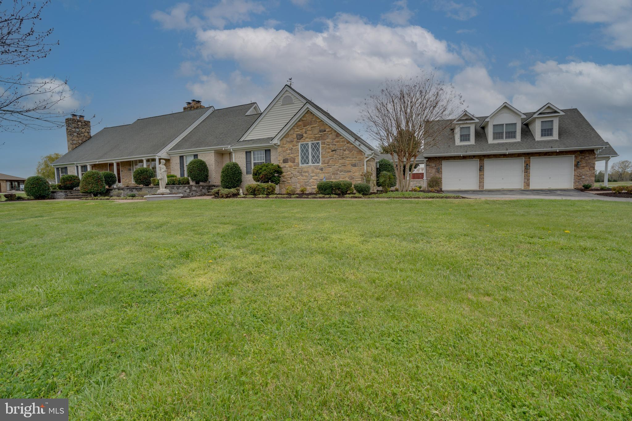 Gorgeous Brick & Stone 2 story 4 bedroom 3 .5 bath Home on 3.17 acres with 2 car Attached Garage and