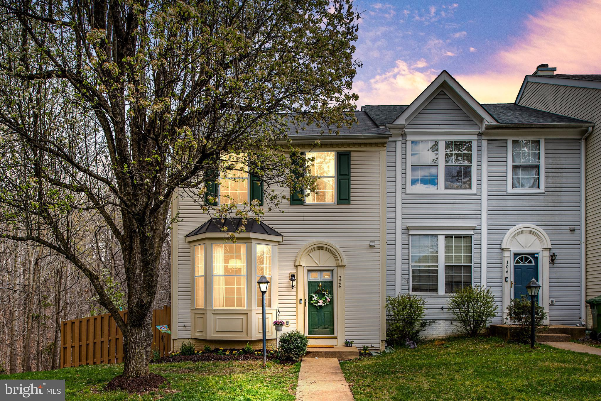 Welcome Home to this private 3 finished level end unit townhome! This home is Move in Ready!  Many r