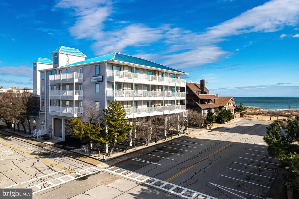 Price improvement for this turn-key unit  at    The Marylander   a building with  great location, views of the Ocean, sun deck on the bay side of the building, indoor pool, game room & on-site management.   AND  only 90 steps until your toes are in the sand!  Enjoy this unit as your personal beach get-a-way OR take advantage of the fact that units in this building enjoy EXCELLENT rental income- all year long, not just 'in season.'   This unit is fully furnished, nicely updated and very well maintained.  It offers a balcony with ocean views and access to the exterior stairs for quick beach access.   The building is just across the street from Northside park where you will find the OC rec center and sports complex,  walk/jog/bike path, crabbing and fishing pier, outdoor concerts and other events throughout the year including the Winterfest of Lights.  You are also walking distance to numerous restaurants, bars and other Ocean City attractions.