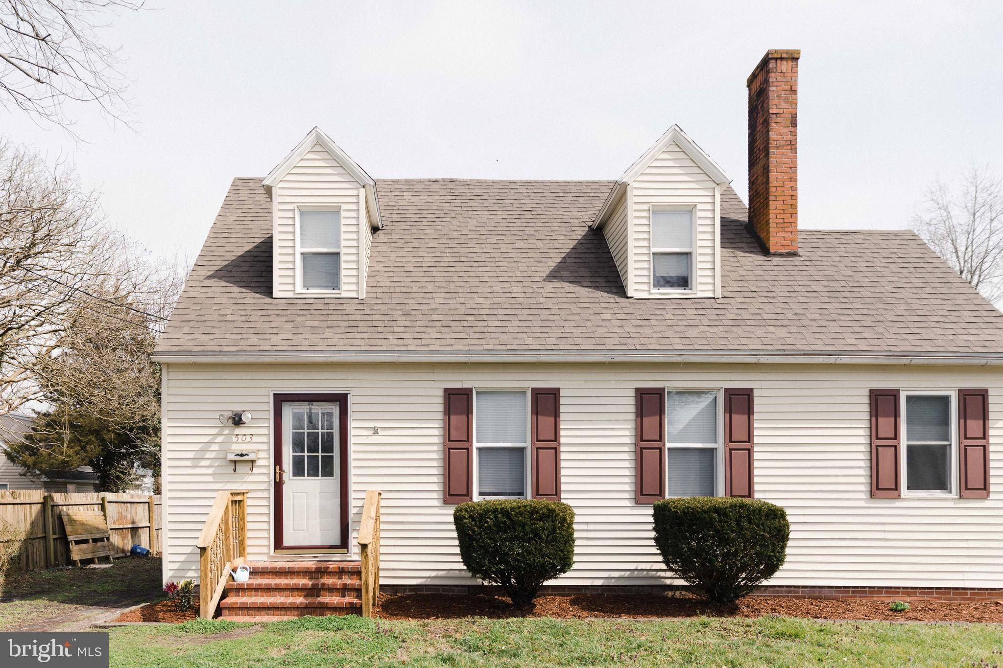 Driving down Walnut St. in Pocomoke City, and this adorable Cape-Cod (sort of) style home just stick