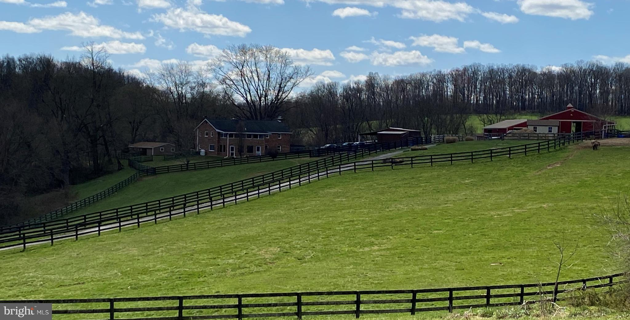LOCATION! LOCATION! LOCATION! 15+ acre turnkey horse farm secluded way off of the main road, surroun