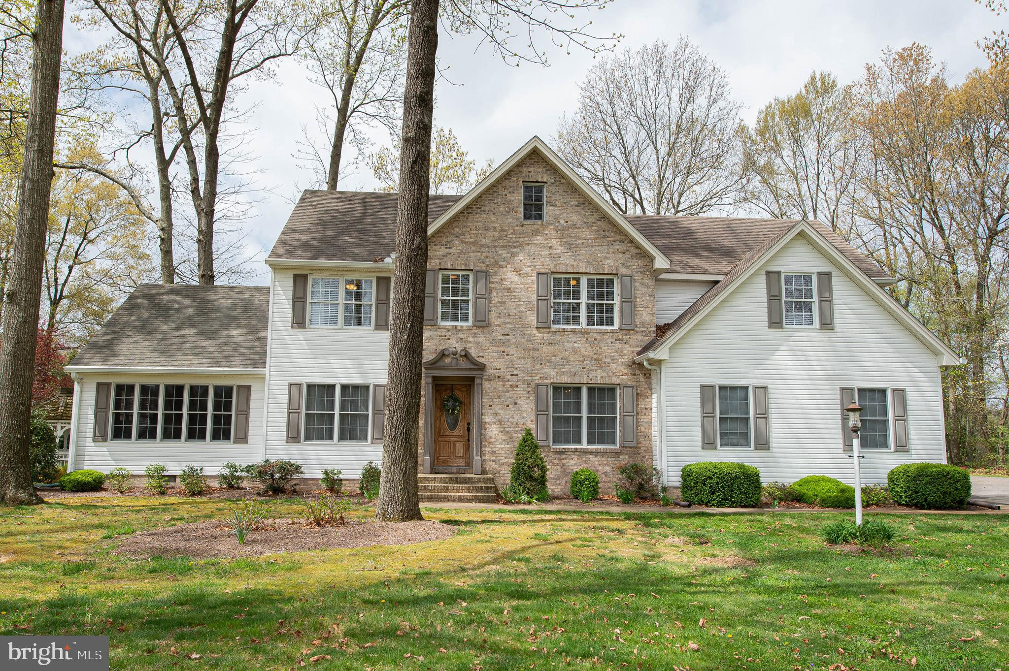 Spacious, tastefully-updated 4BR/3.5BA contemporary twist on a center hall colonial, sited on a room