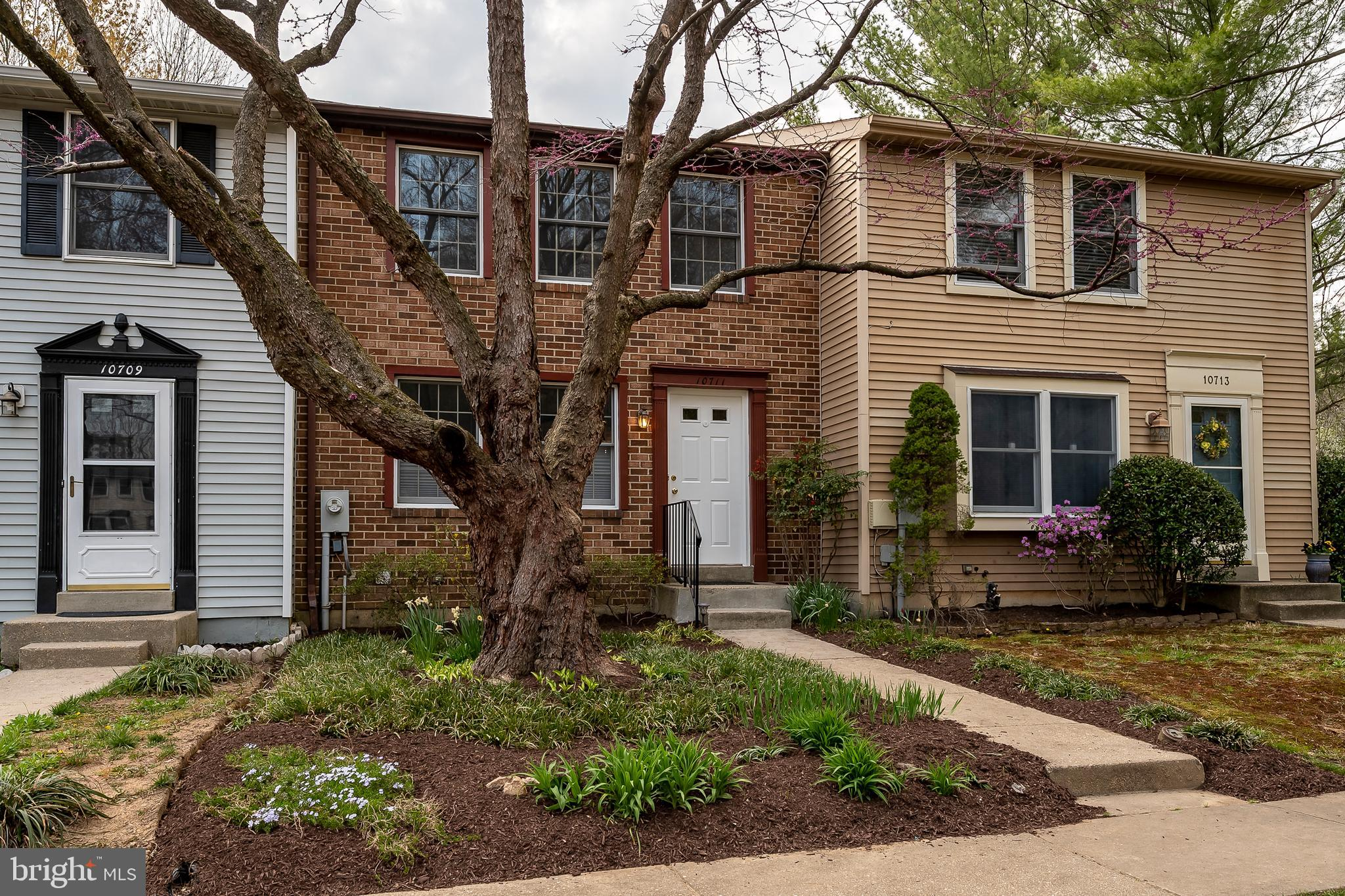 Gorgeous brick front Townhome: features include 2 large upper level bedrooms with 2 baths; extensive