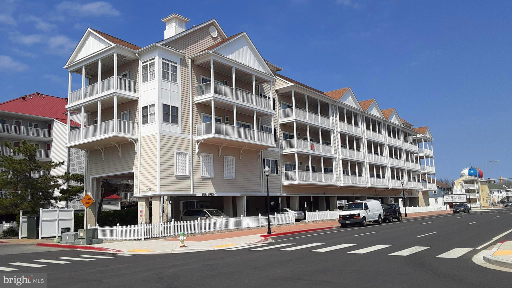 Pristine, turn key condo in fabulous downtown Ocean City location! Just two short blocks to the beach and all the excitement and activity that the Boardwalk has to offer including amusements, bars, restaurants and special events. Enjoy ocean, inlet and  city views  from your oversized balcony. Spacious, open floor plan with two large bedrooms, two  full baths and a gas fireplace to warm chilly nights.  A walk-in closet adjoins the master bedroom.  Beautiful, fully equipped  kitchen features granite counter tops, tile flooring,  plenty of cabinets and an island with bar seating.  A hand painted seascape mural accents the entry way.  Master bath offers a jetted soaking tub, double sinks and a separate shower.  Convenient parking with two assigned spaces underneath the building. This meticulously maintained, fully furnished condo is the perfect vacation home for your family or the ideal rental/investment opportunity.  Schedule your appointment today!