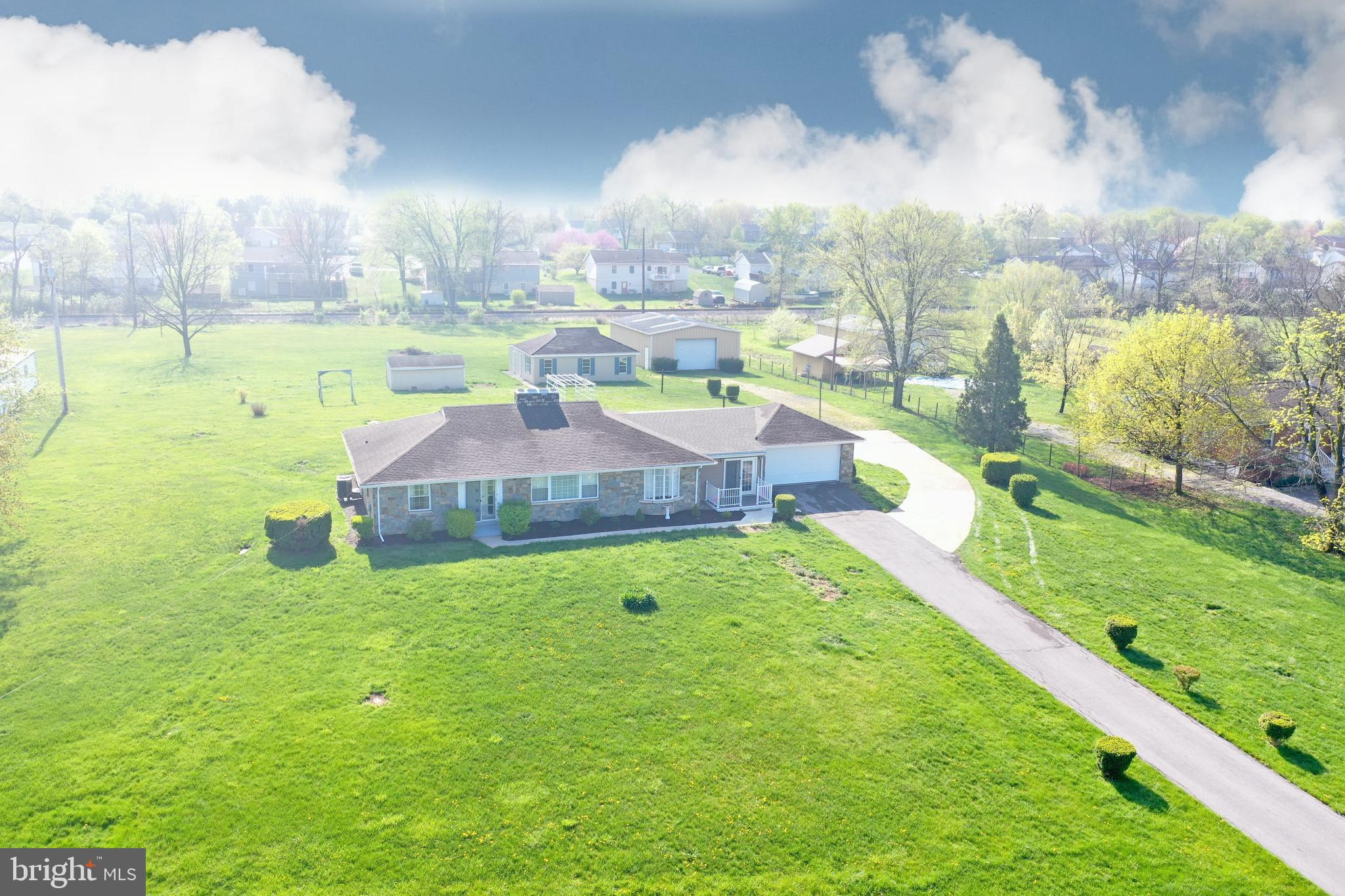 UNRESTRICTED 1.93 acres with a Rare Stone Rancher with a full basement with a 50 X !5 Great Room wit