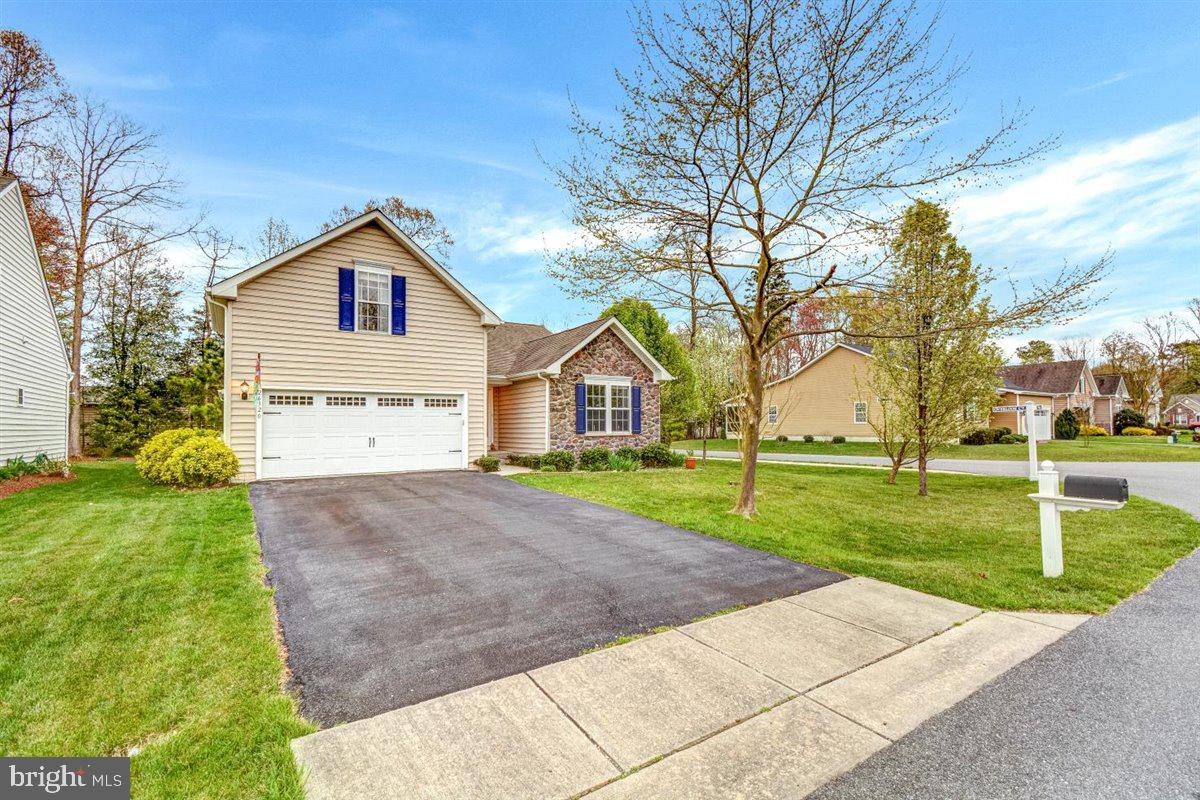 Upgraded 4 bedroom, 2 bath home on a corner lot in lovely Long Neck Shores. Community Pool. Home fea