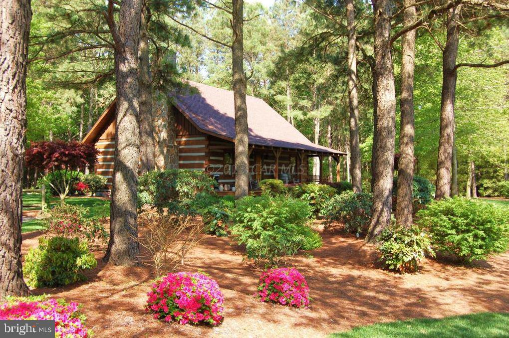 What a find!  This Hearthstone log cabin is situated on 5 wooded acres and offers a beautiful pond t