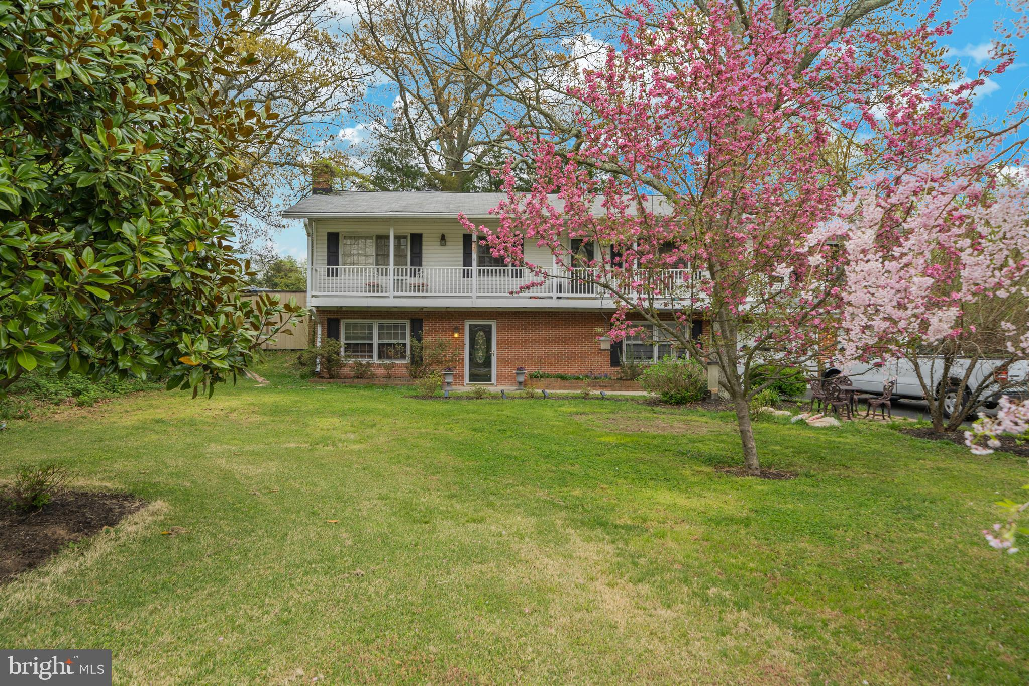 **OPEN HOUSE SUNDAY 4/21 12-2PM**  Surrounded by beautiful greenery, with a magnolia tree and cherry