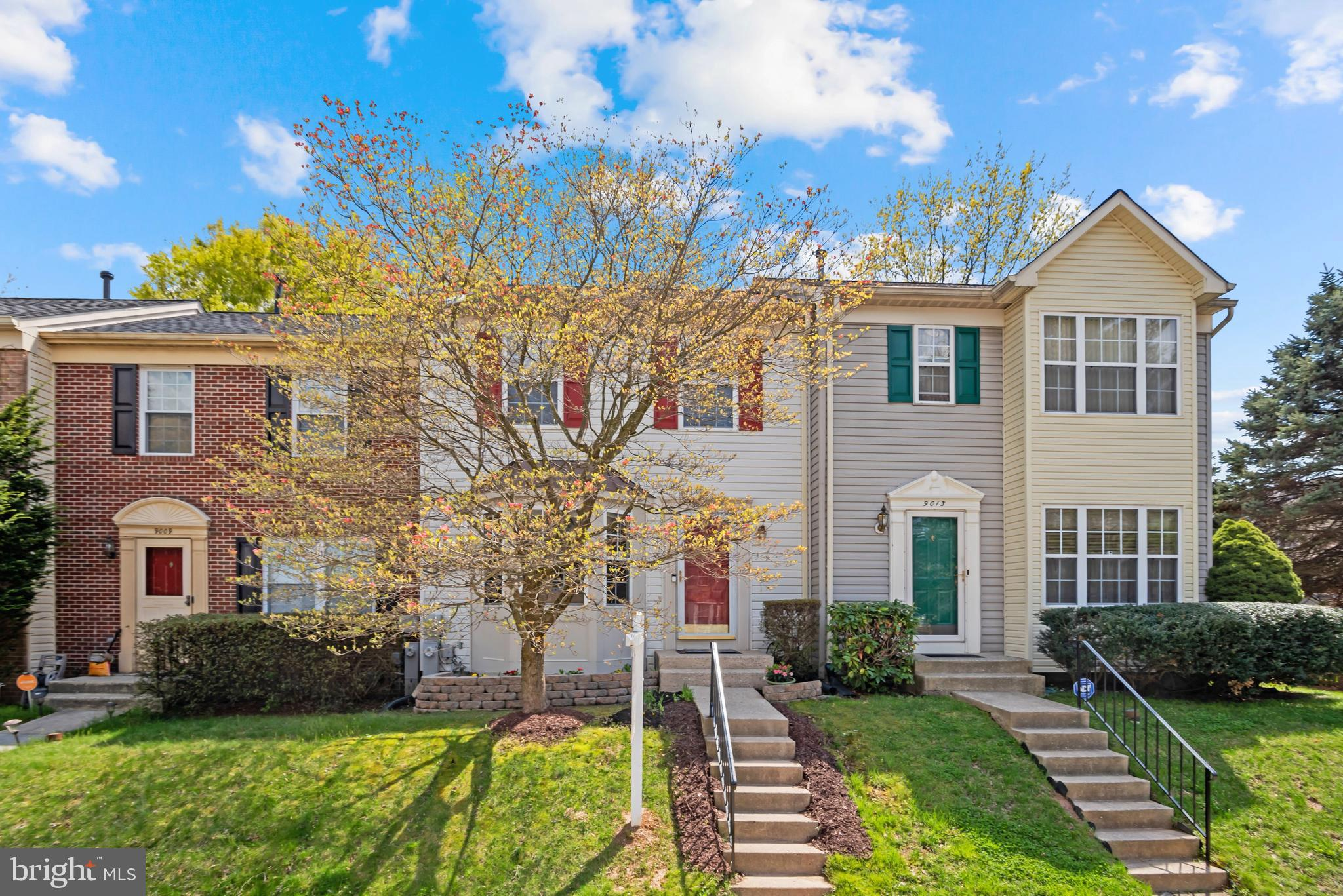 Updated, rarely available home in the sought-after Oakwood Village Community. Natural light that dances throughout the main level, highlighting gorgeous hardwood floors (2020). The spacious kitchen features recessed lighting, ceiling fan, and new appliances (2019). Enjoy a meal in the breakfast nook as you watch birds and butterflies delight in your beautifully landscaped front yard on warm spring days. The open floor plan of the main level offers ample space to gather with those you care about as laughter and conversation fill your home. Share a meal in your dining room, host a movie night in your family room, or grill out on your deck as you overlook the woods behind your home. The lower level is perfect for cuddling up on chilling evenings in front of your wood burning fireplace. Updated laundry and storage (2018) complete the lower level. When you are ready to relax ascend to your top level to your private primary bedroom with an ensuite full bath. Stay cool in the summer and warm in winter, HVAC system replaced in 2017 and new roof installed 2015