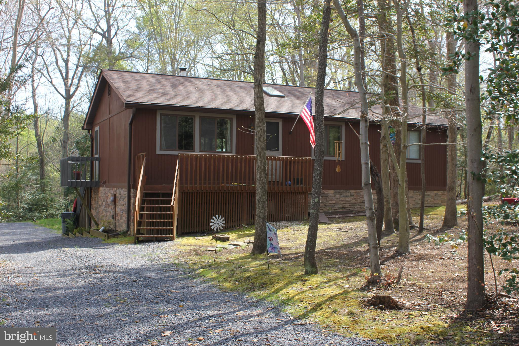 Almost hidden away, this single family 2 or 3 bedroom, 2 bath home on over an acre backs to protecte