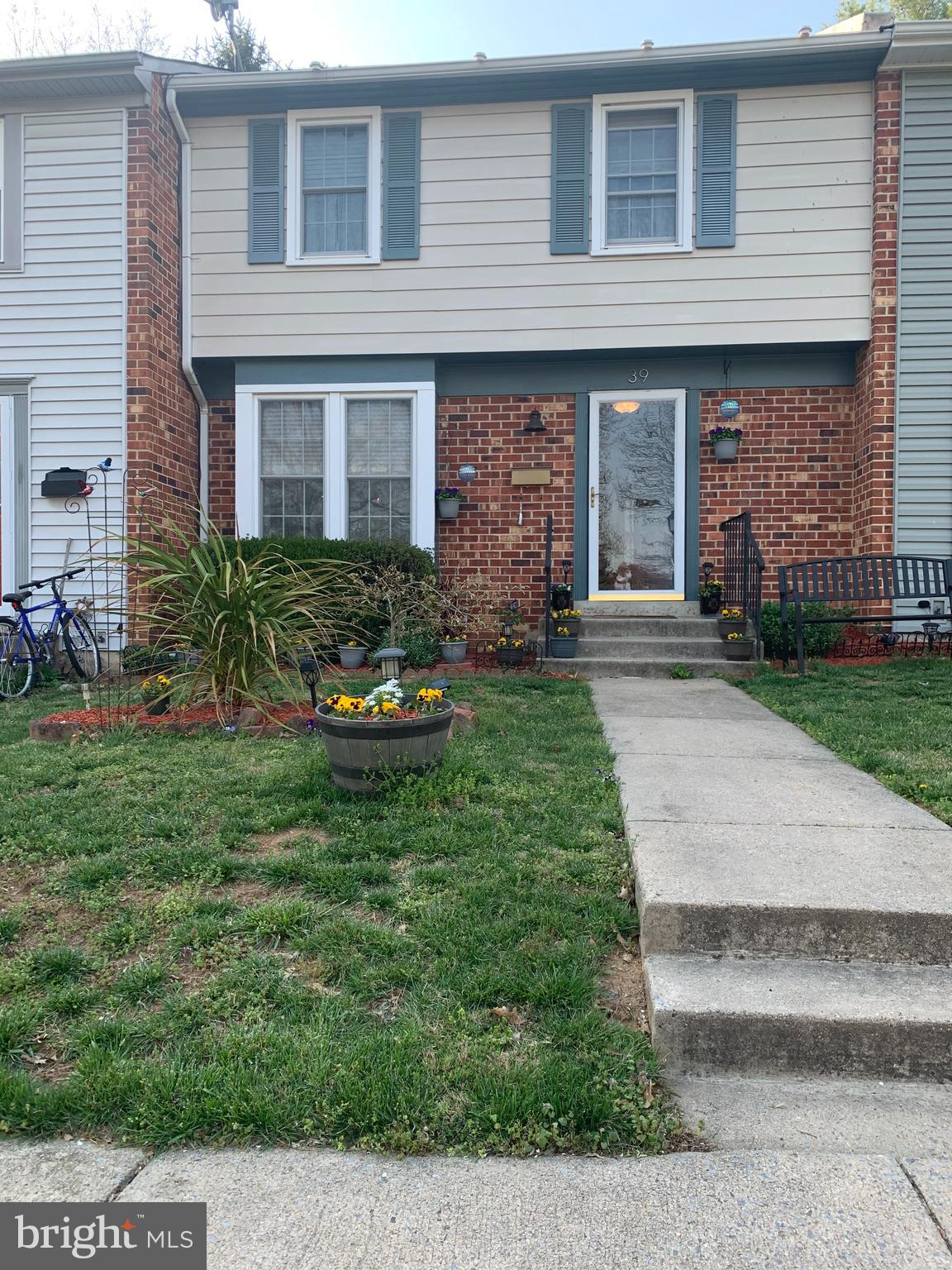 Brick front three bedroom, two full bath, two half bath townhome with updates in kitchen and baths.