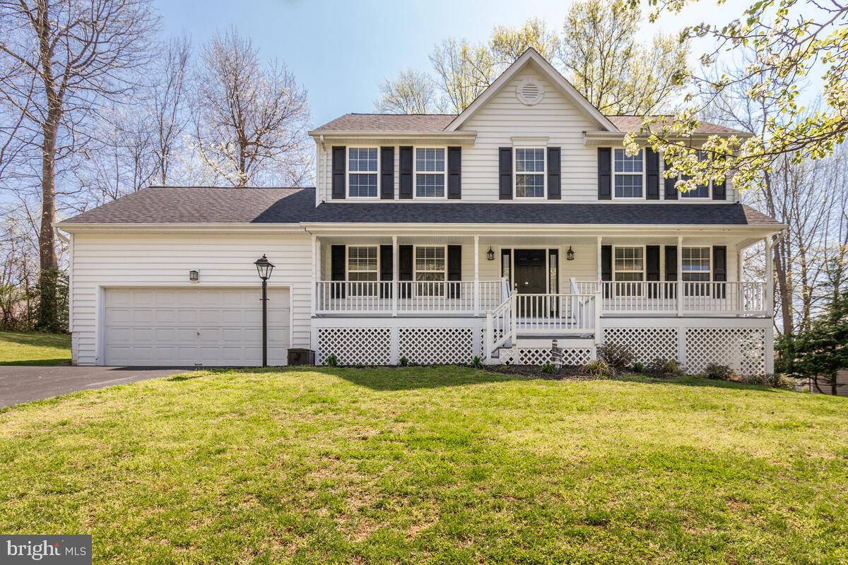 This immaculate updated colonial,  in a quiet and desirable community, is calling your name! Welcome