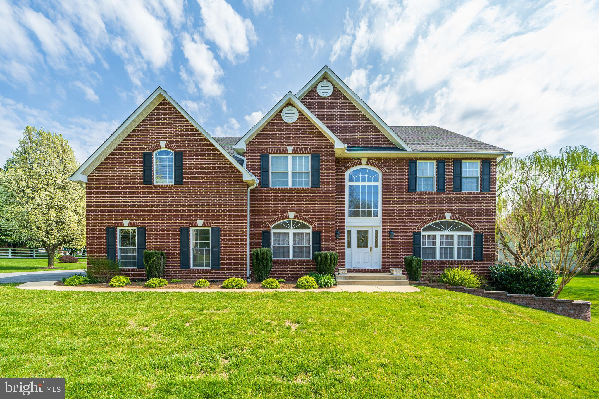 Come home to this gorgeous three level brick colonial in sought after Cabin Branch!!! This house has