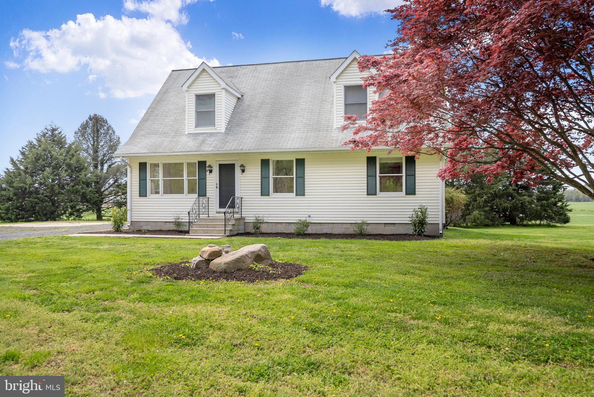 Spacious house surrounded by woods and farmland.   3 bedrooms and 1.5 baths on the main floor with a
