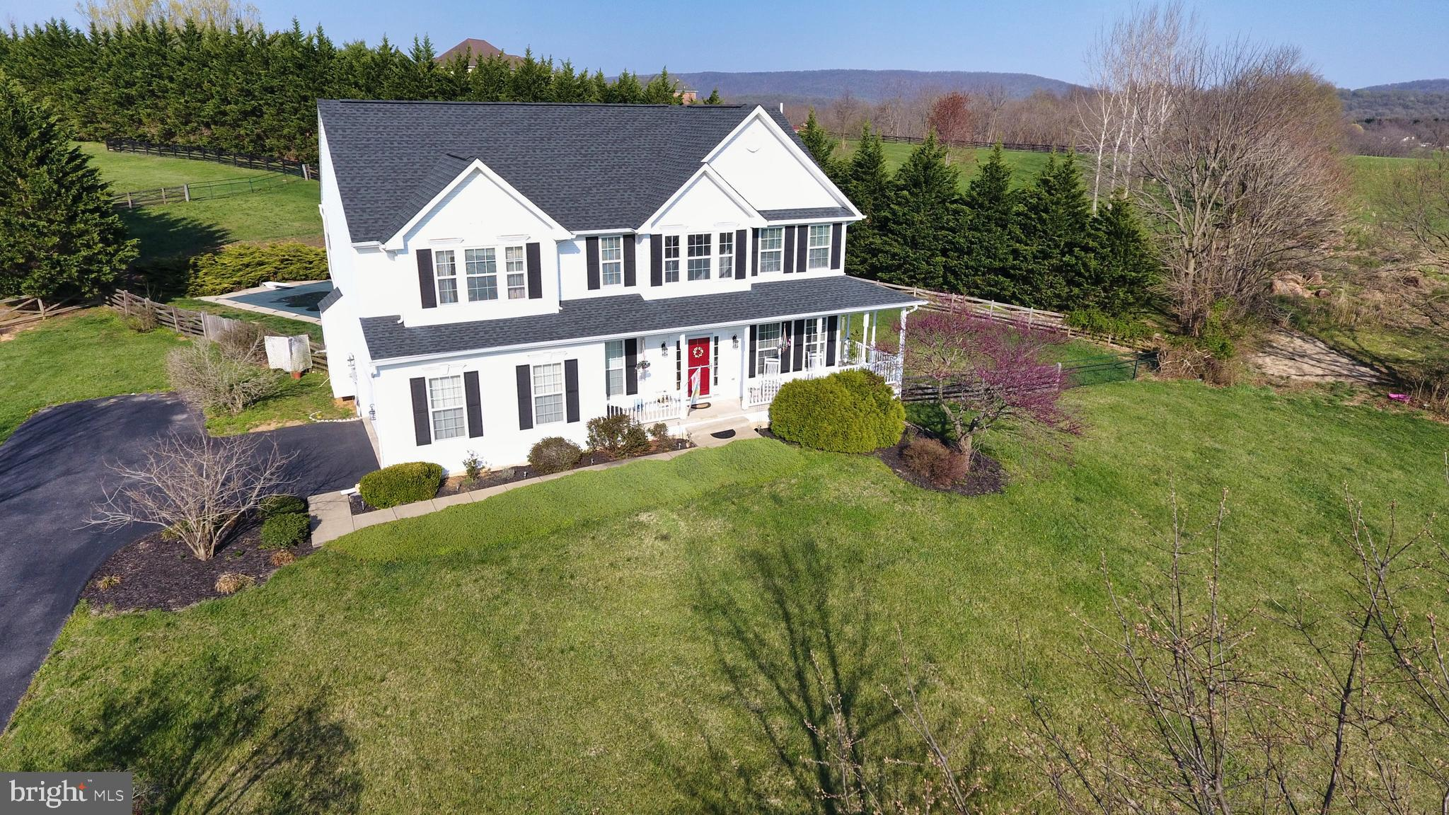Tour this beautiful Colonial resting on an acre of rural land with beautiful Mountain Views! This ho