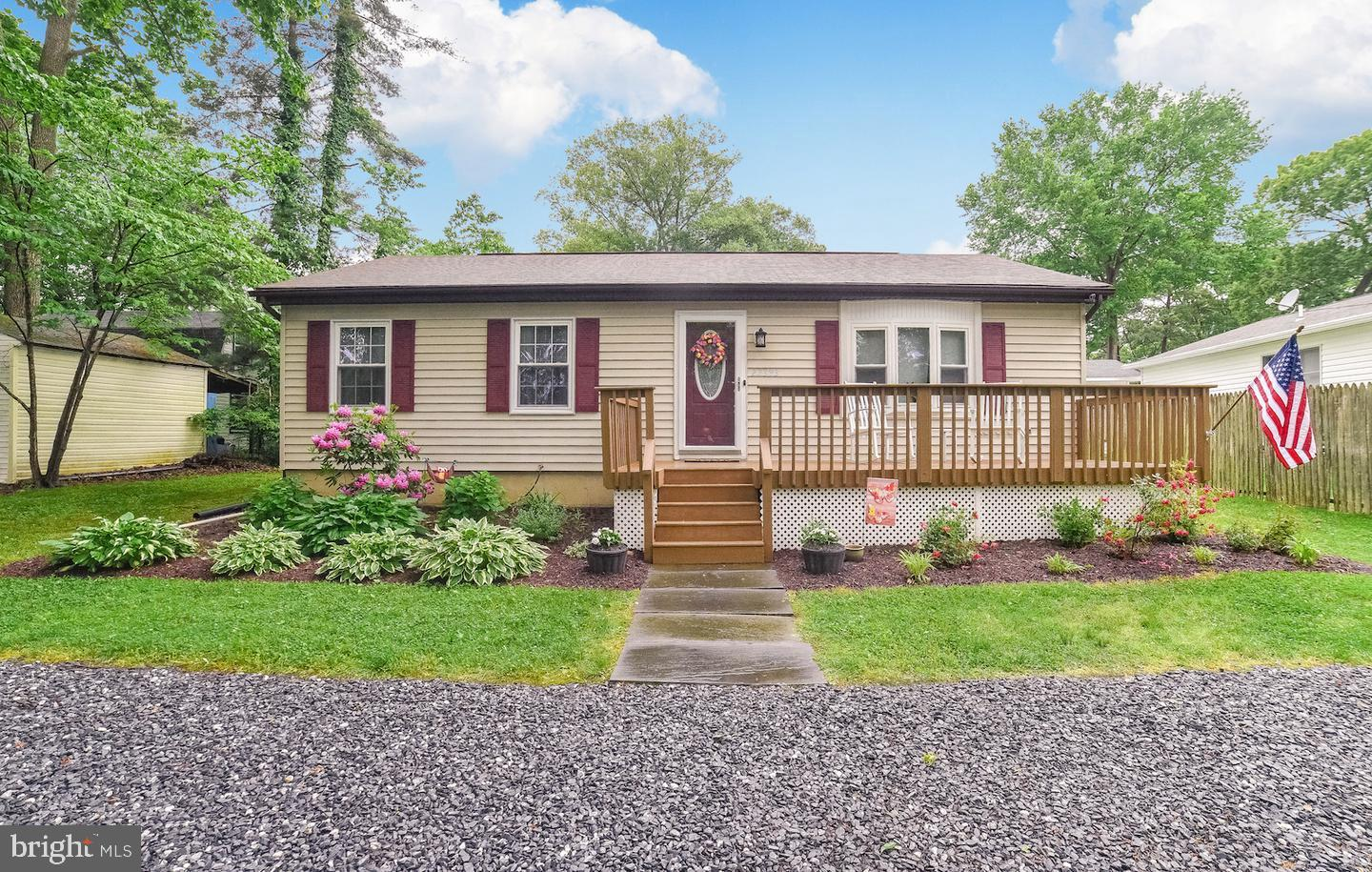 This home is in a water  oriented community. Three Bedroom and one bath.  Front and Rear decks. Five